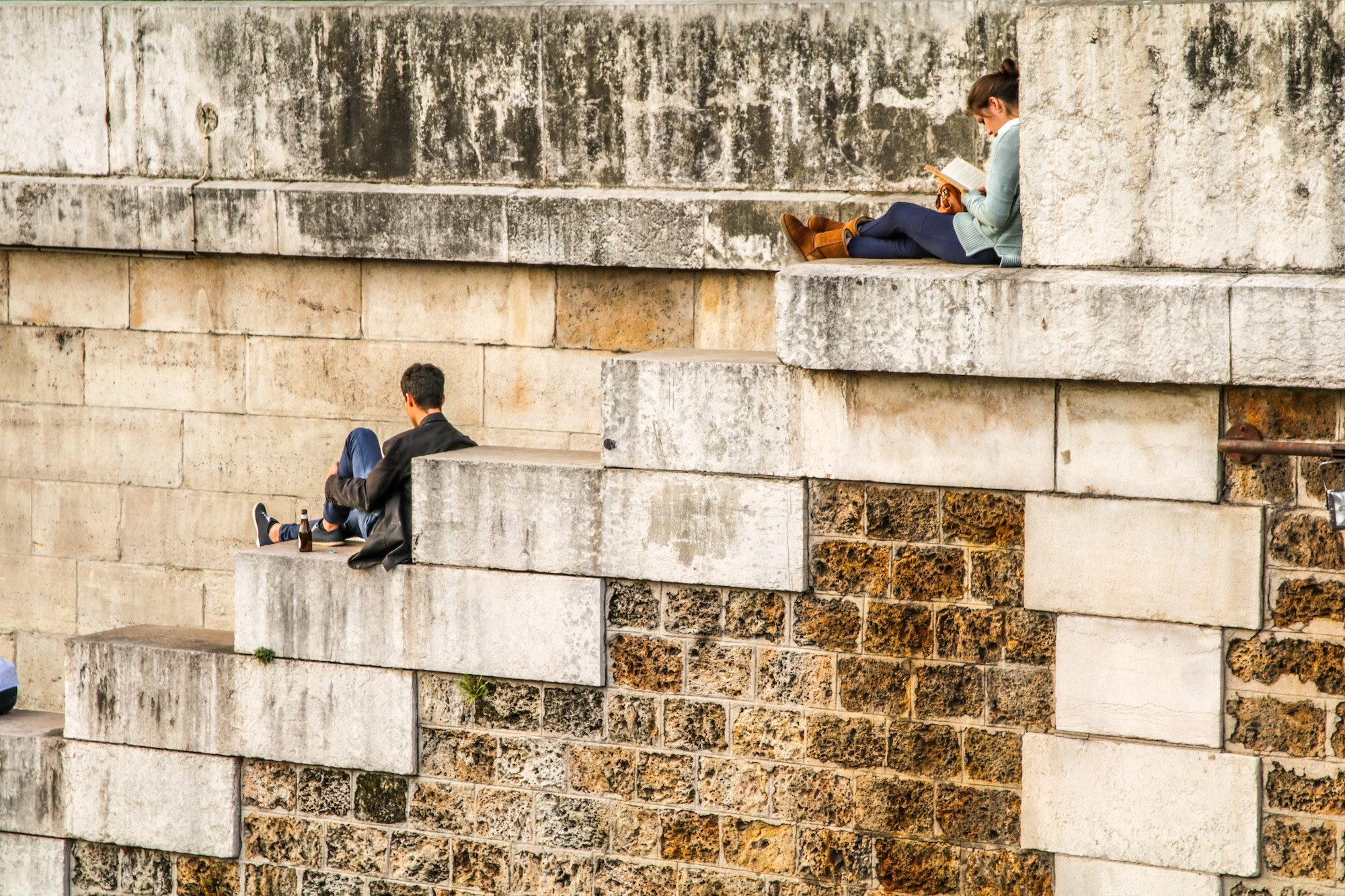 Paris in summer is quiet and it's possible to have its corners to yourself, like these two people reading quietly on the banks of the River Seine.