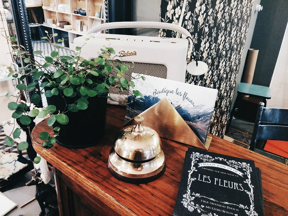 Vintage finds like an old telephone (left) and old hotel reception bell (right) at Les Fleurs home decoration store in Paris.