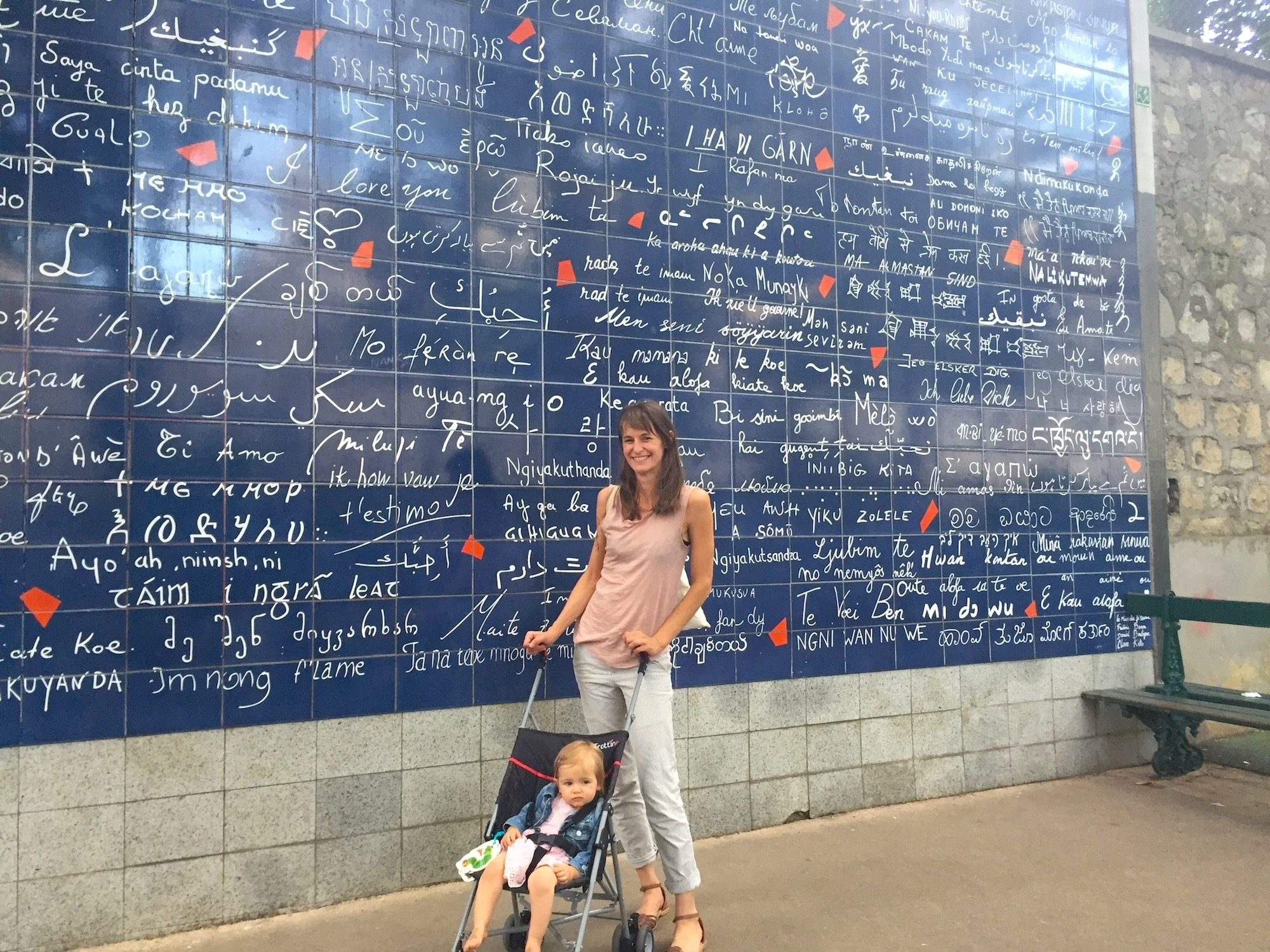 HiP Paris Blog explores what it's like traveling to Paris with babies, and for this mommy posing in front of the wall of I love yous with her baby in a stroller, it's easy because there's lots to do, even in hilly Montmartre.