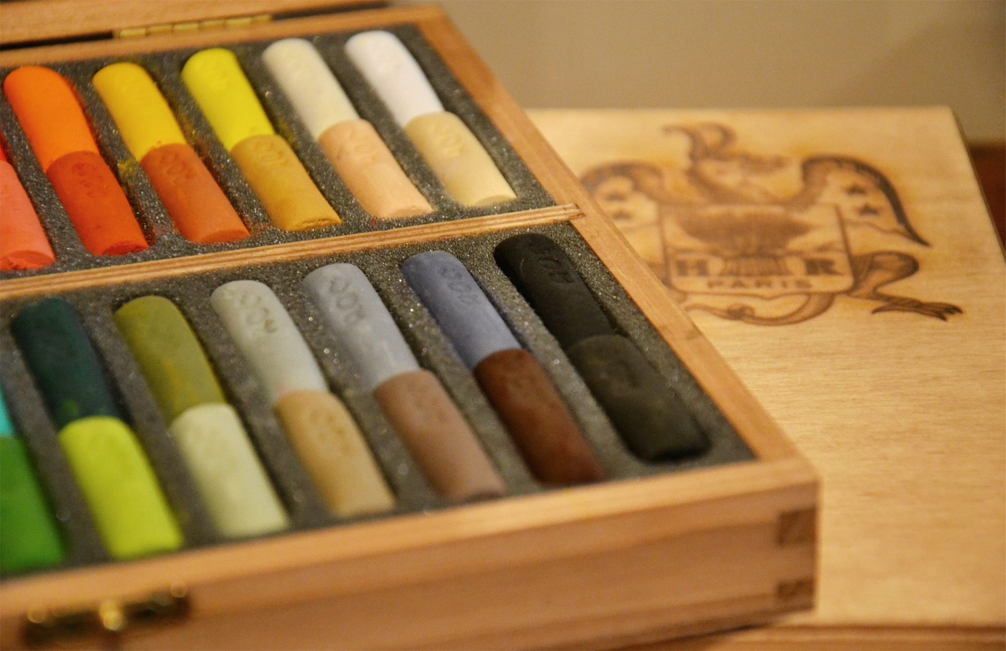 The Maison du Pastel art store in Paris sells the most beautiful colors of pastels all traditionally made, like this open wooden box of yellows, grays and oranges.