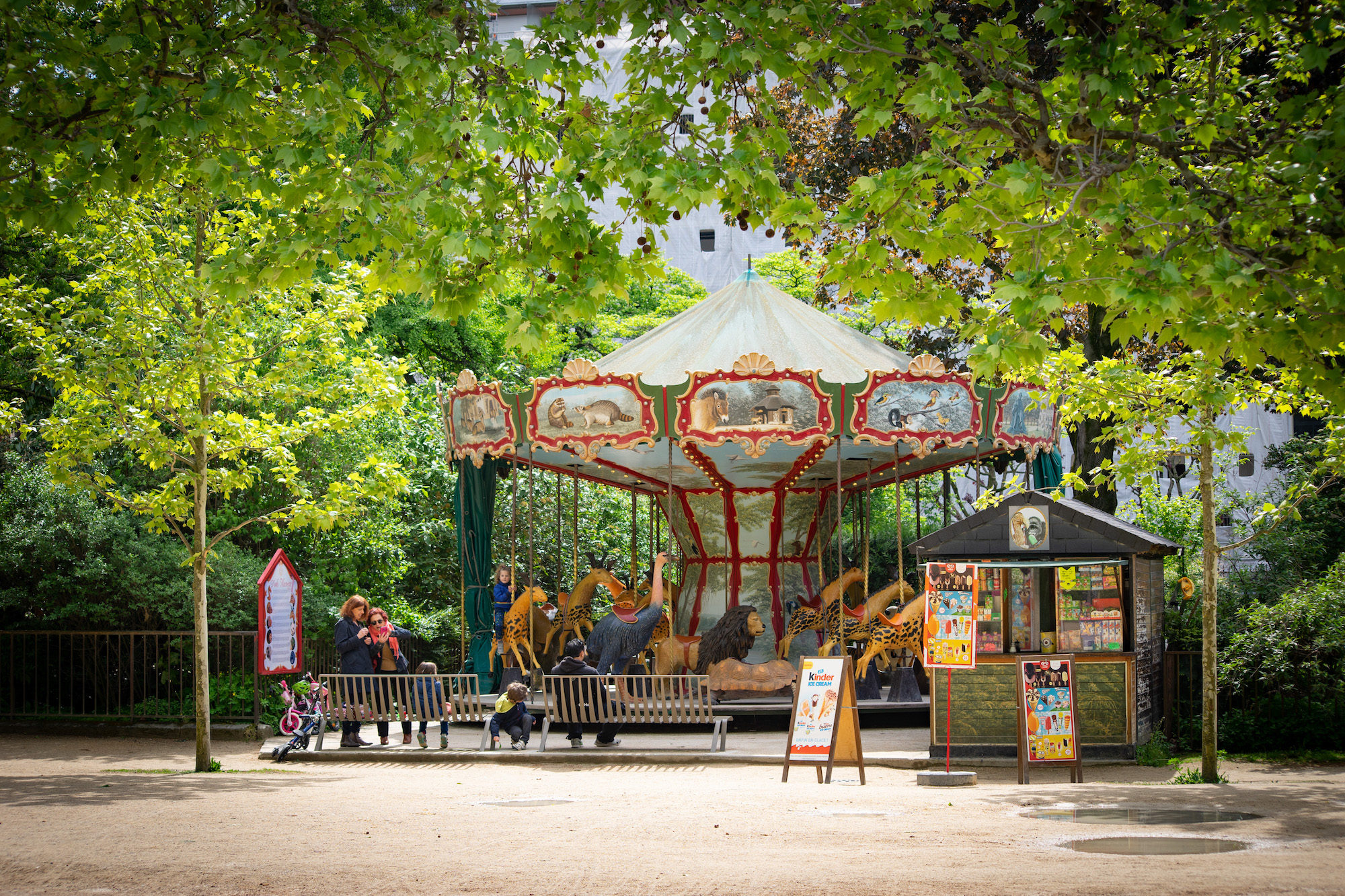 Kids in Paris love the colorful merry-go-rounds dotted about the city.