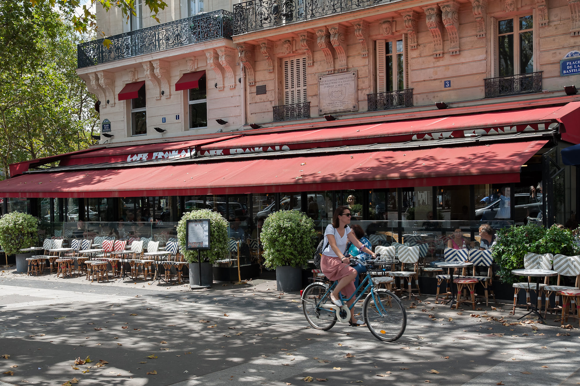Biking in Paris is the best way of exploring its many squares lined by picturesque cafés, especially in summer.
