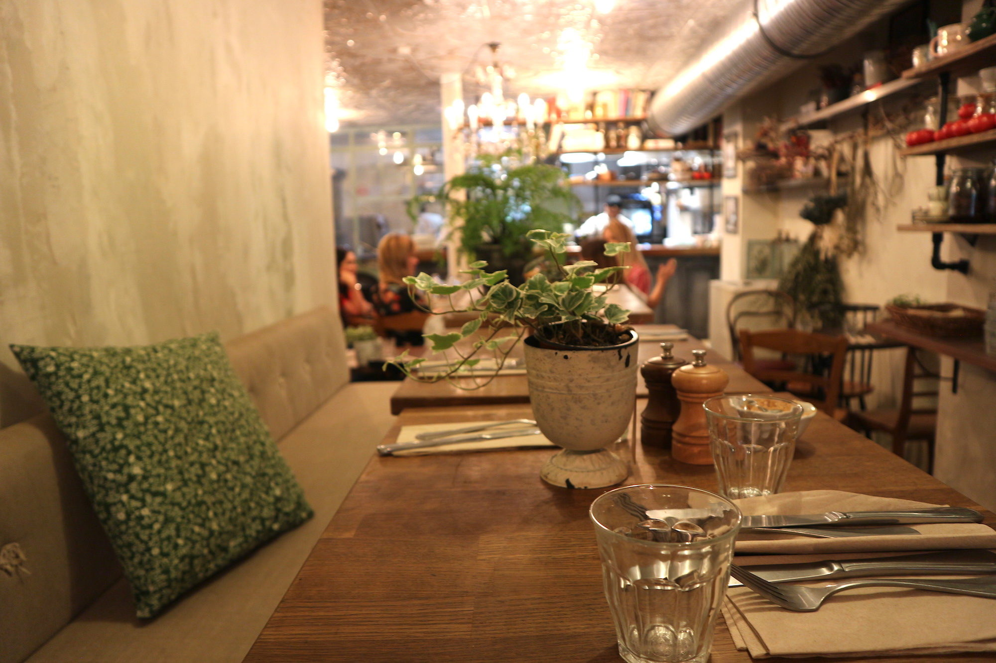 Inside one of the best coffee shops in Paris, Treize au Jardin, comes with wooden tables and cozy banquettes.