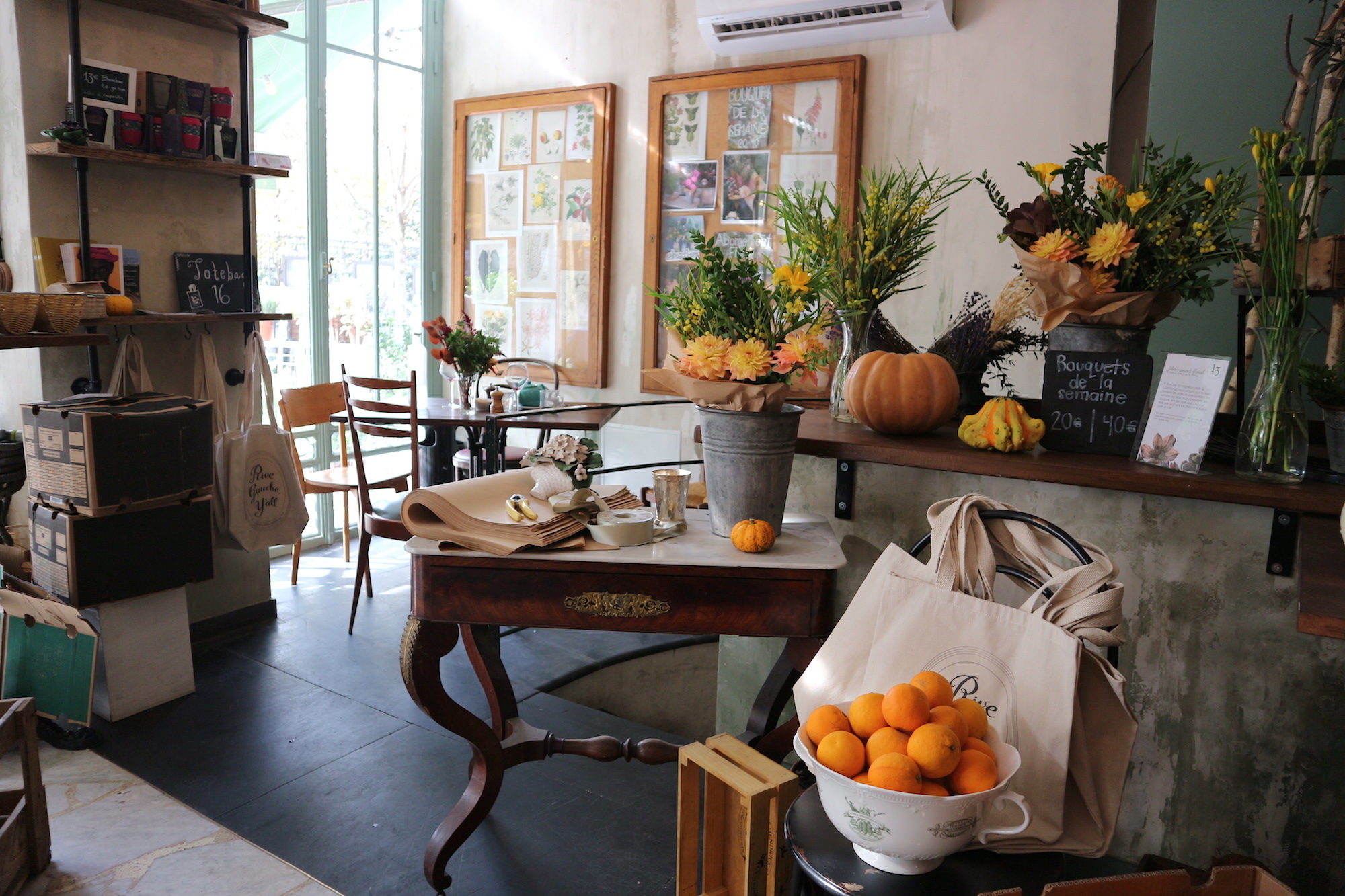 Inside Treize au Jardin coffee shop in Paris, where the rustic decor with plants and fruit reflect the home-made food served here.