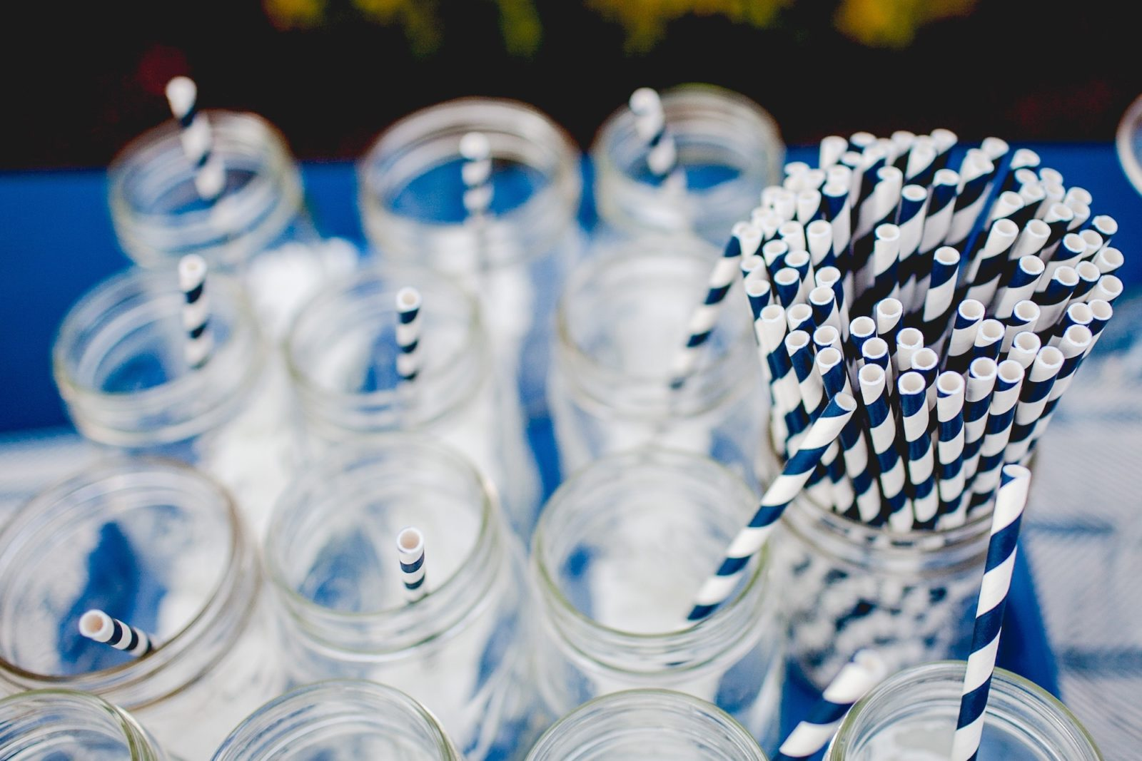 HiP Paris Blog: France's plastic ban on cups, straws and all single use plastic means you should be getting a paper straw like these stripy blue and white ones or no straw at all in your cocktails in Paris and across the country from now on.