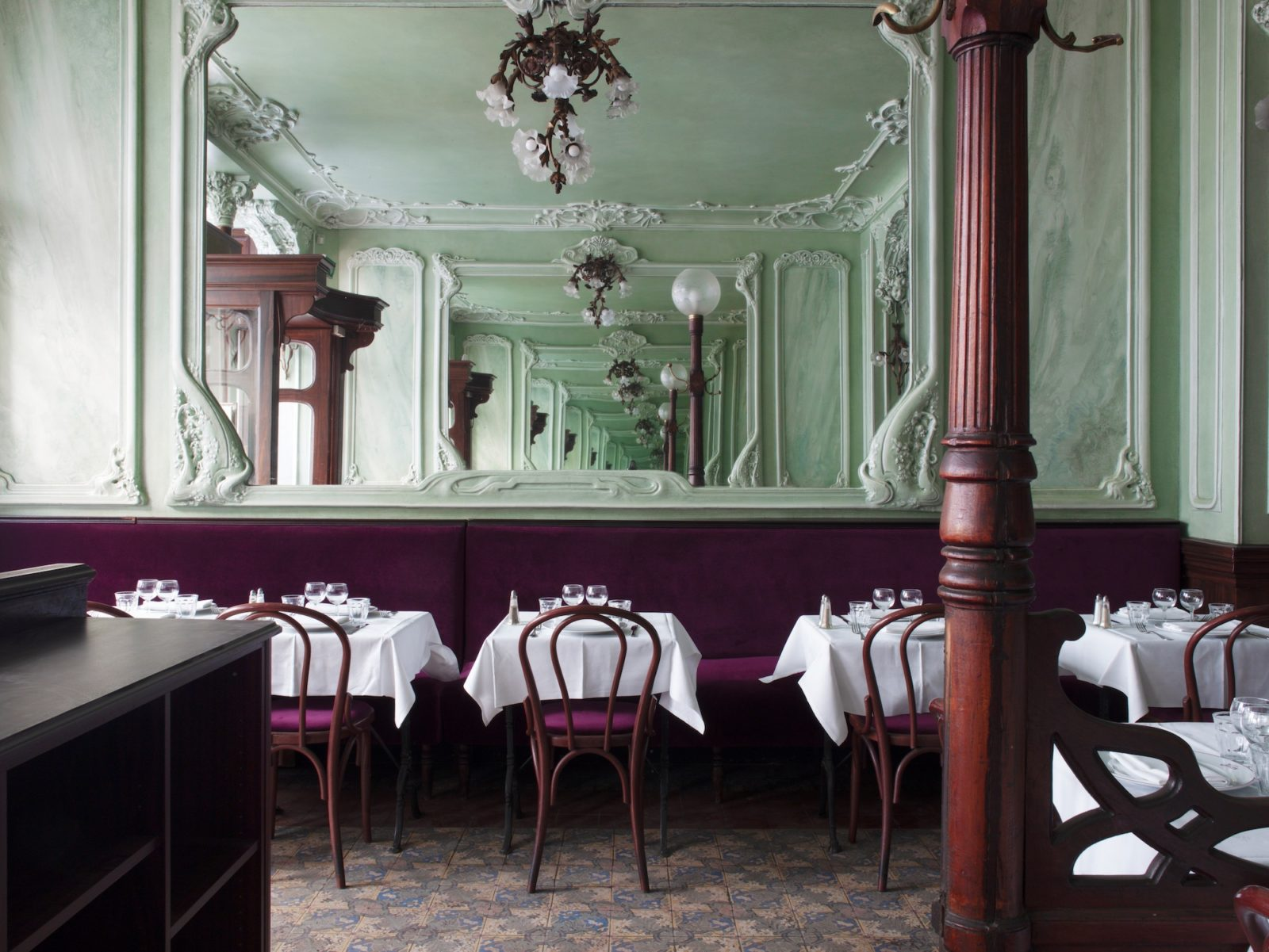 Bouillon Julien restaurant in Paris comes with spectacular Art Nouveau interiors and classic French food for travelers on a budget.