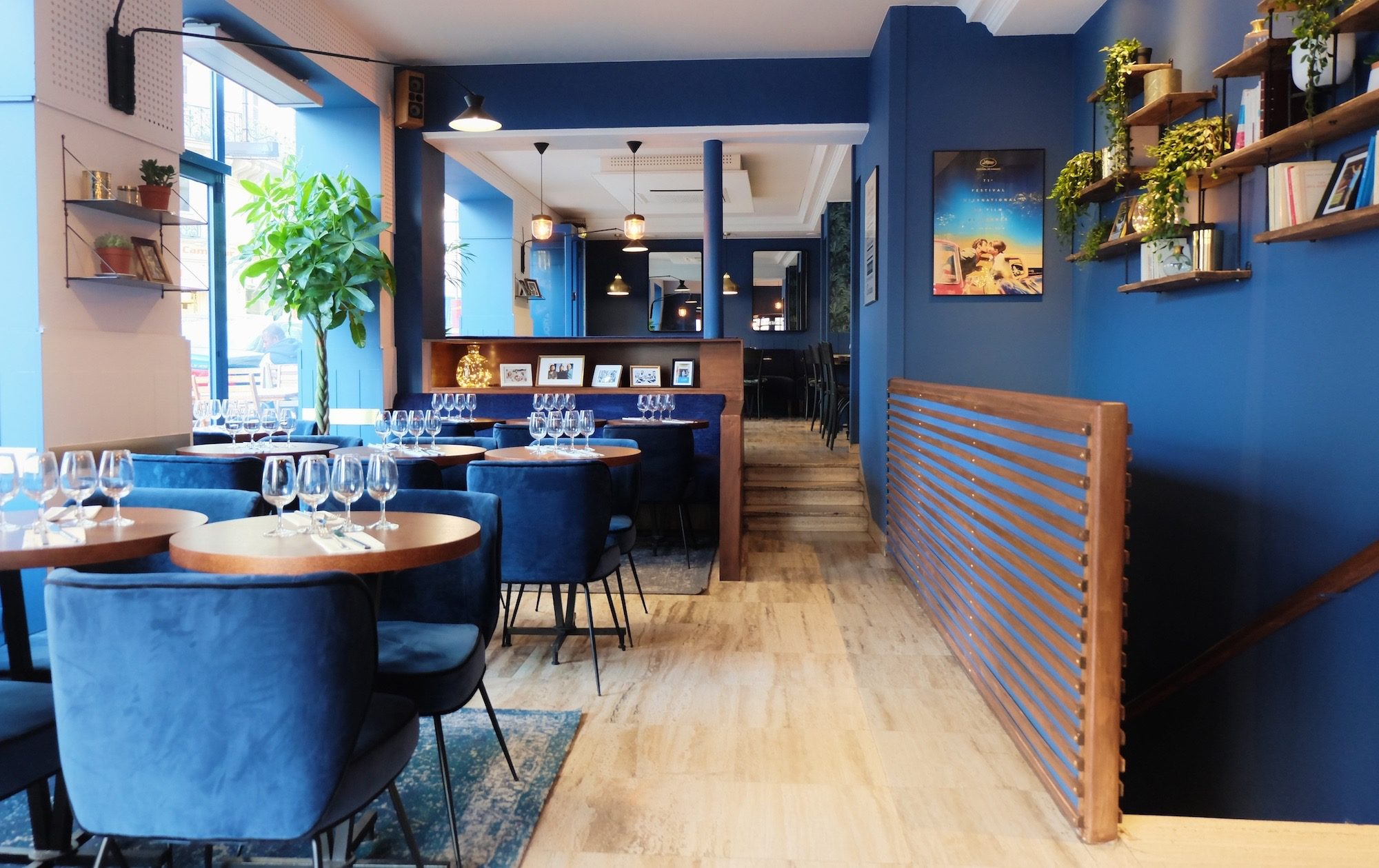 L'Invitée restaurant near Notre Dame Cathedral is one of our favorite spots to eat in Paris for the French food but also for the sleek and cheerful blue interiors