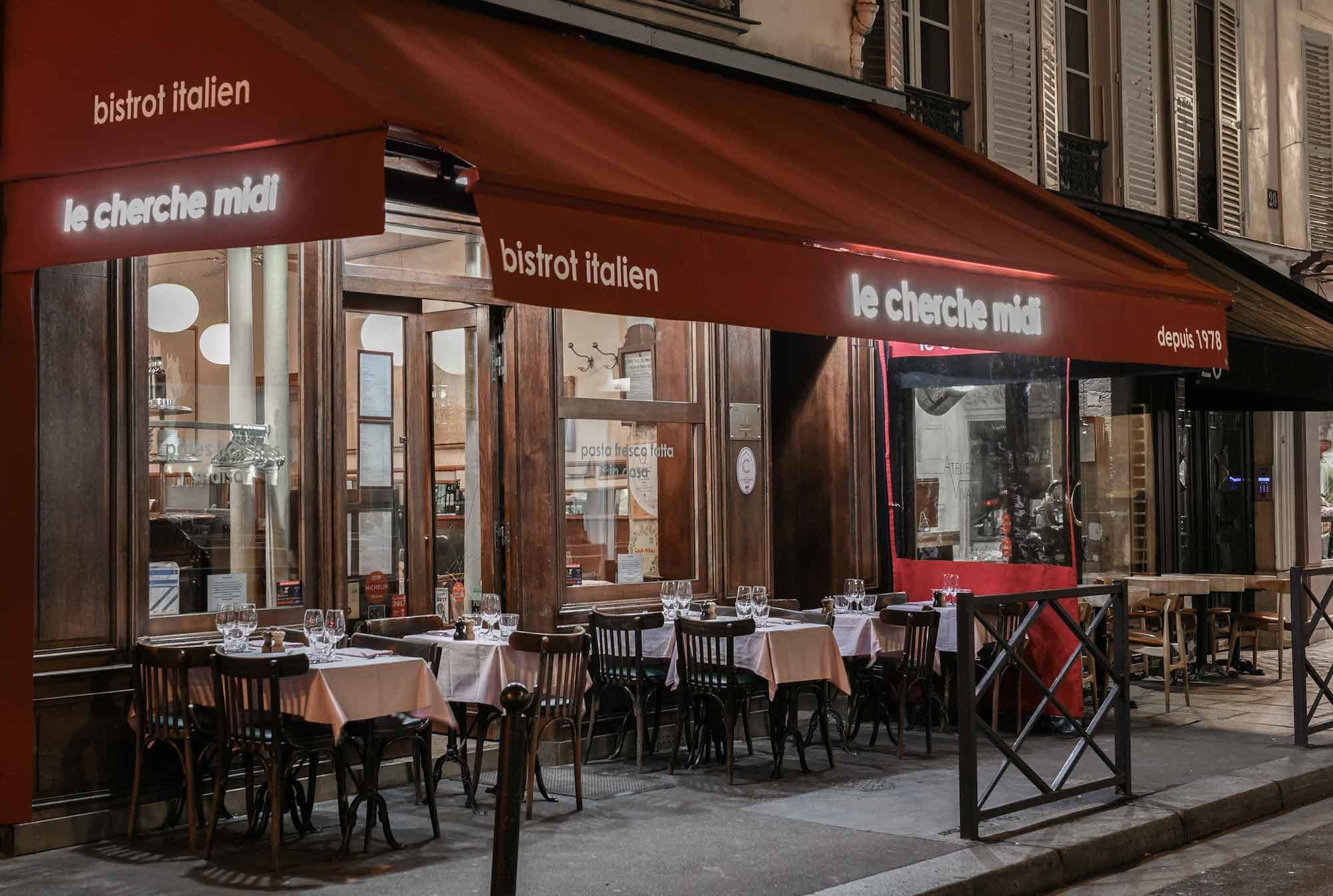Some of Paris' best restaurants are to be found on rue du Cherche-Midi like this quaint bistro with a red awning over an outdoor terrace.