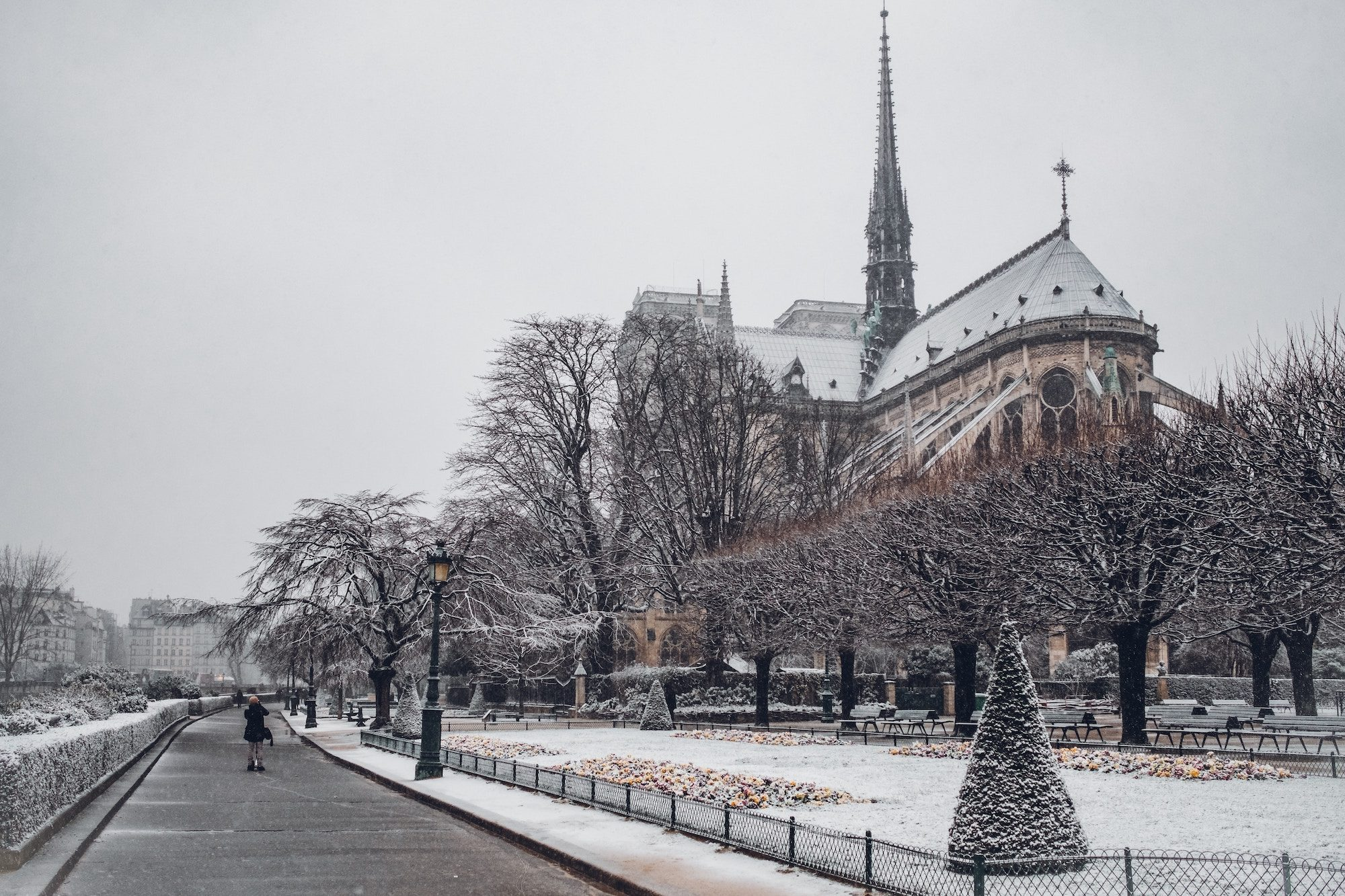 When it's cold and snowing outside in Paris, like in this picture of Notre Dame Cathedral, what could be better than staying inside and listening to one of our favorite podcasts?