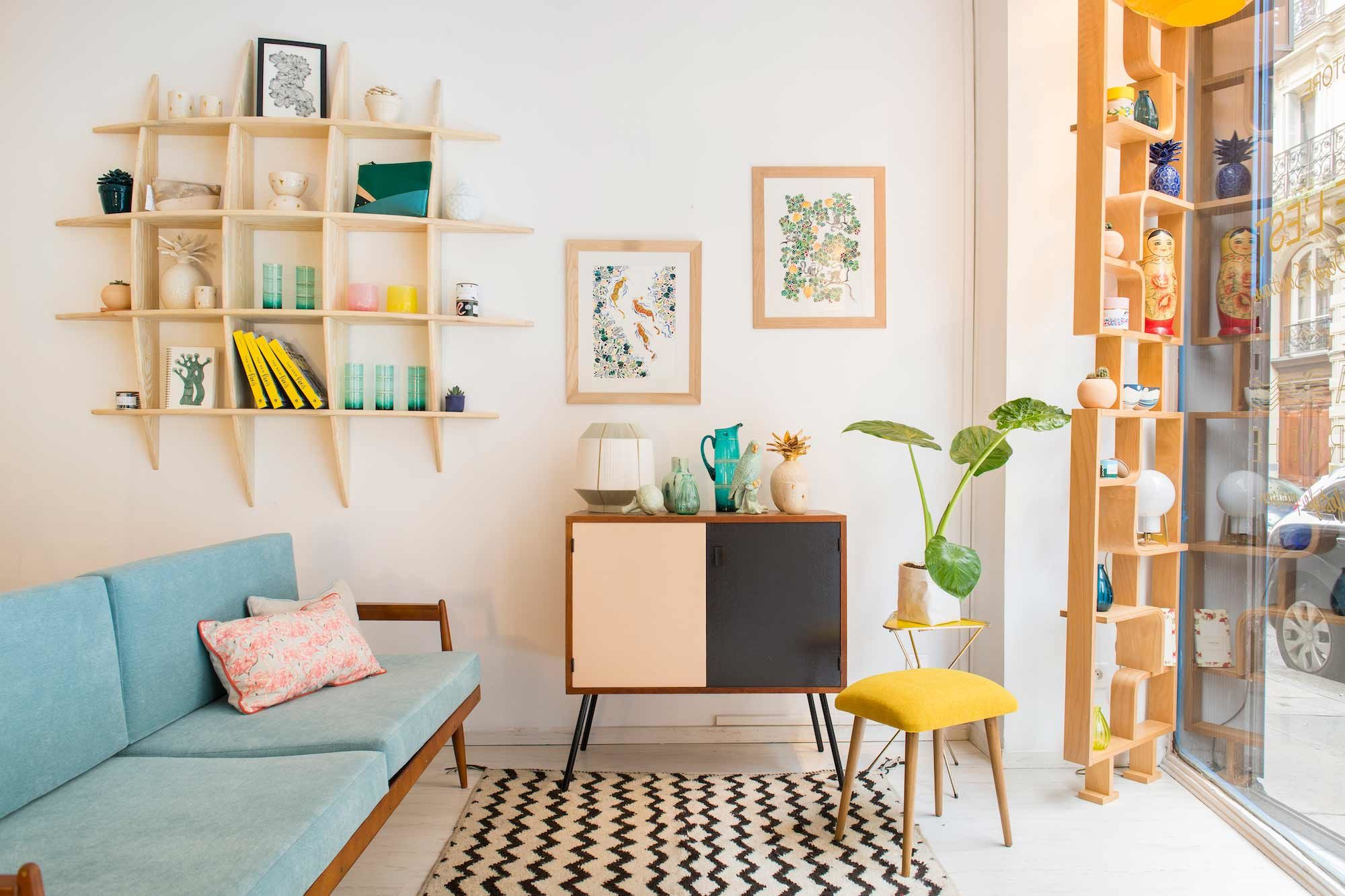 Bloc de l'Est is a cool furniture concept store in Paris' South Pigalle area with a 50s to 80s Soviet style, like this duck egg blue sofa and mustard-yellow stool.