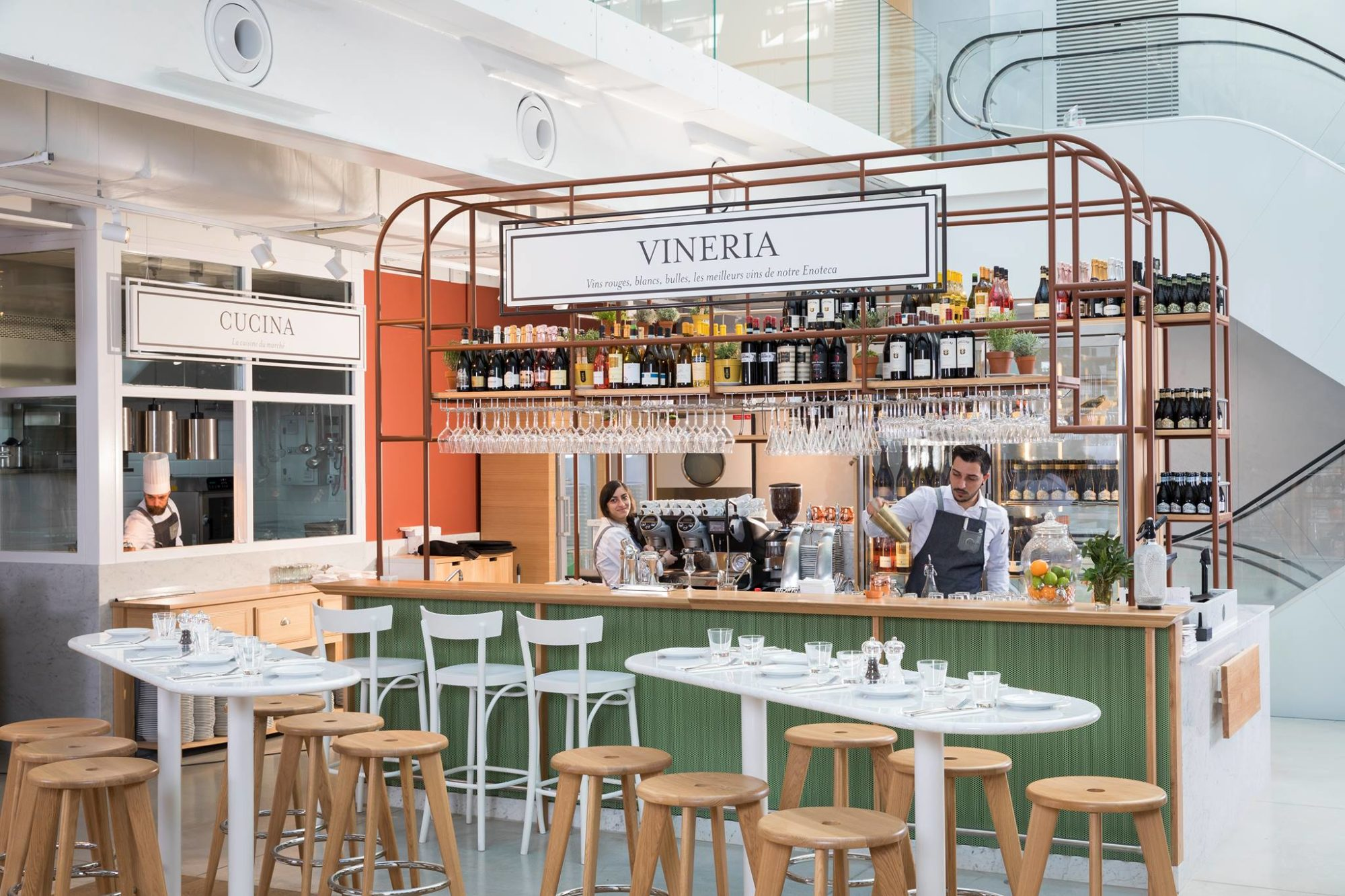 The bar and antipasti restaurant at Eataly in Paris comes with bright and light interiors.