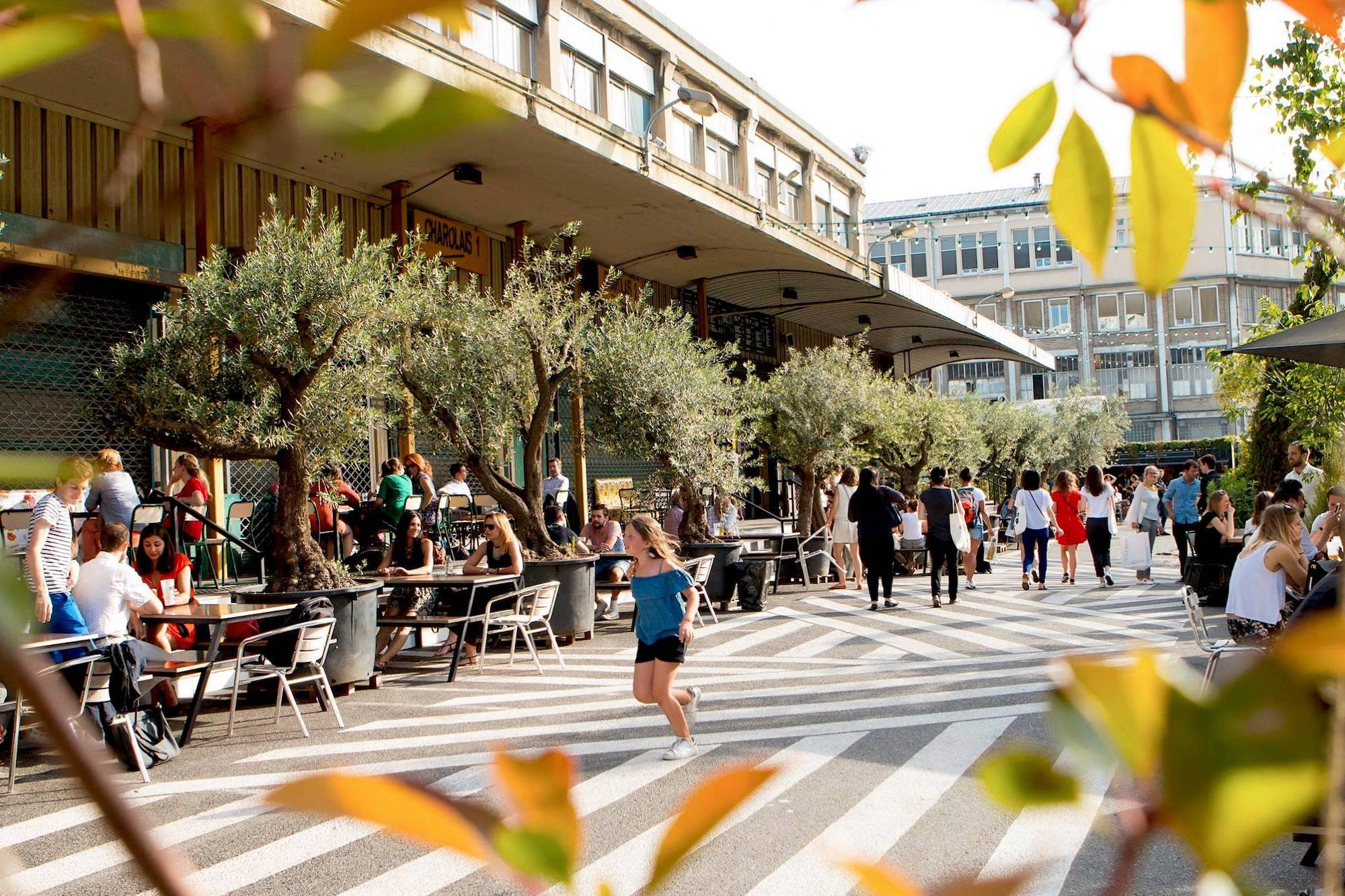 Ground Control is one of our favorite terraces in Paris in summer as it has a large outdoor space with potted olive trees and plenty of food options.