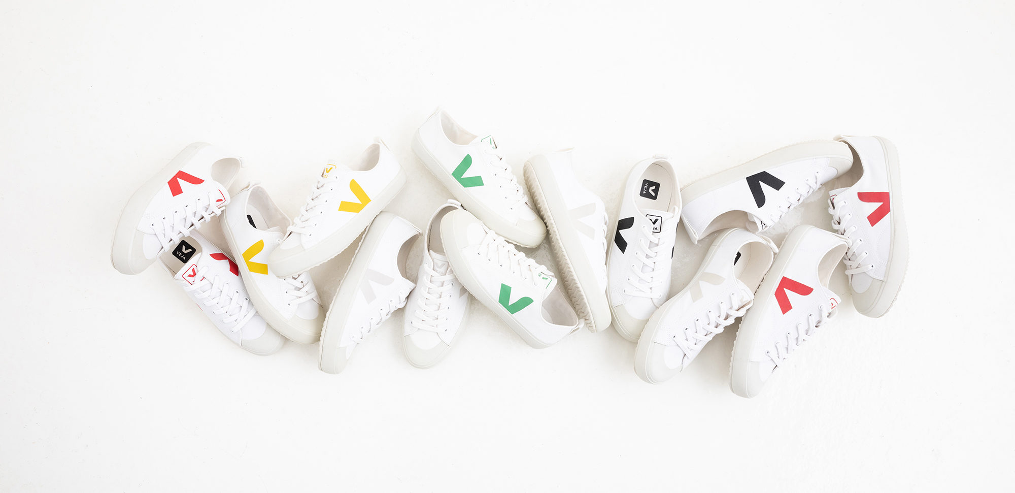 Veja trainers are our go-to sneakers for looking like a Parisian as they come in white with different color logos.