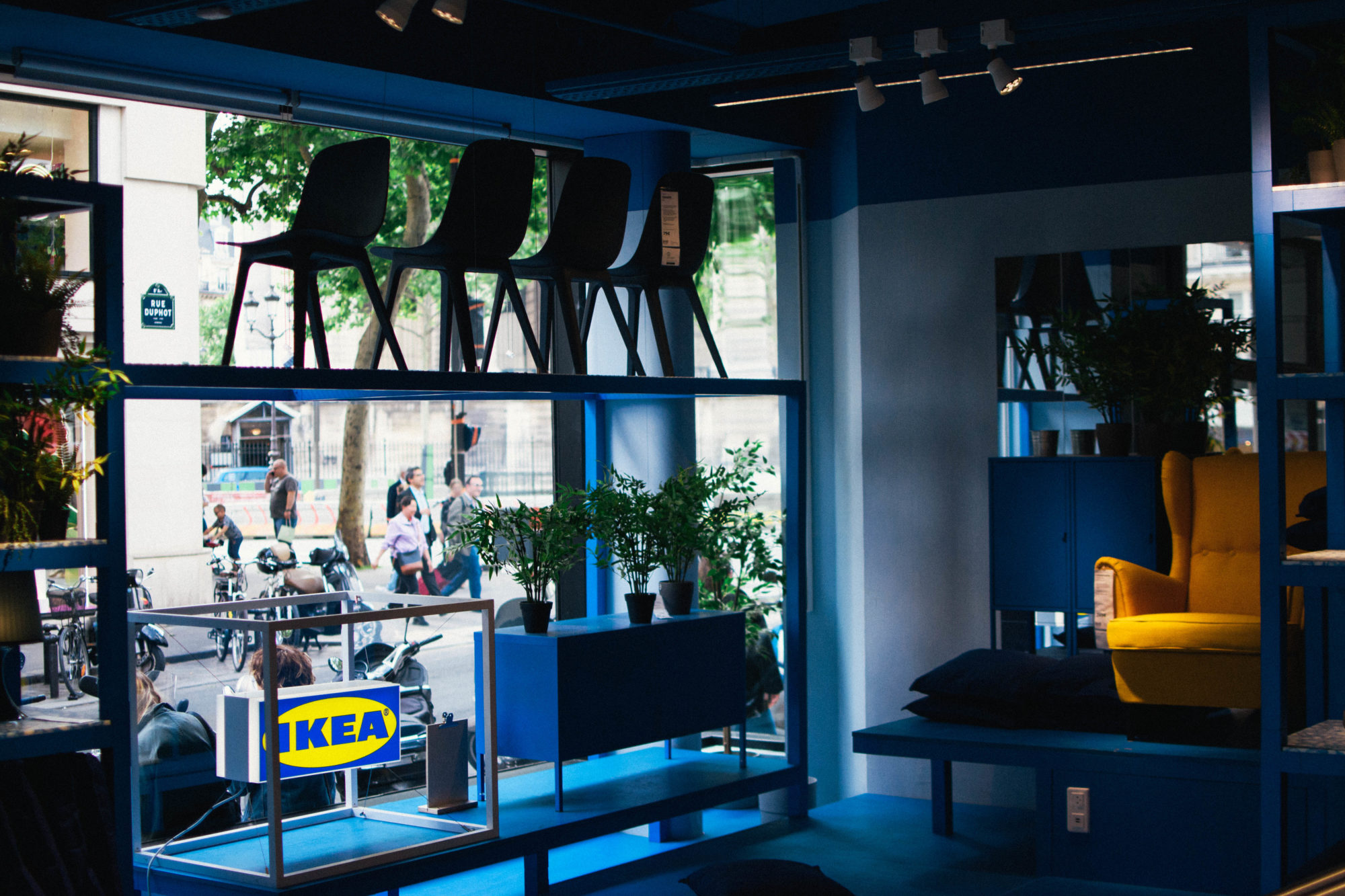 A blue and yellow furniture display in IKEA Paris La Madeleine