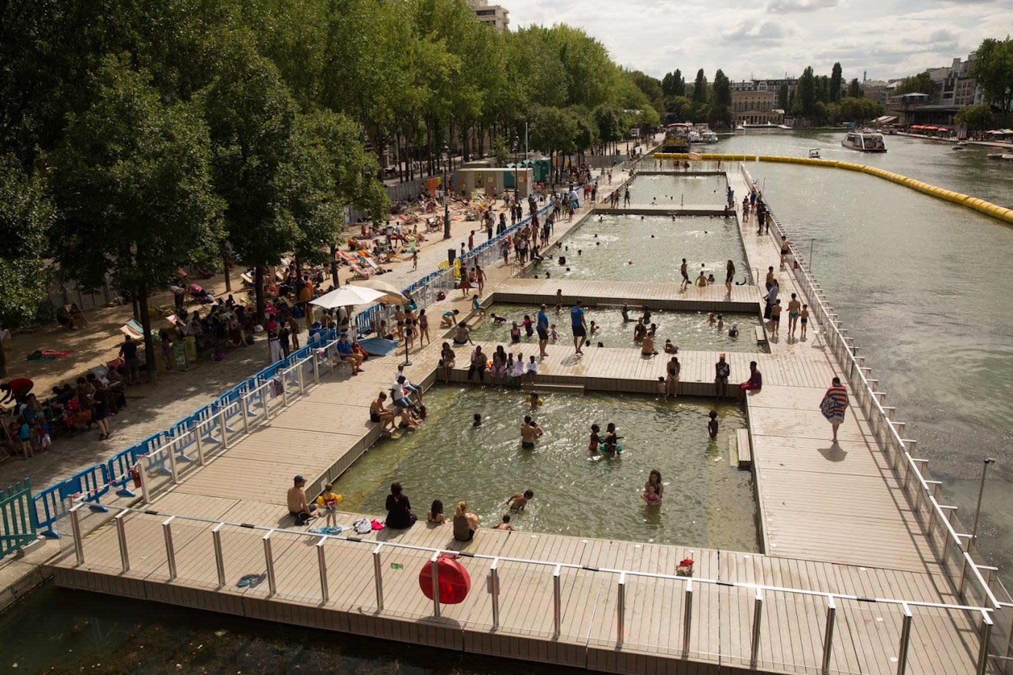 A view of Paris Plages on the Canal de l'Ourcq where you can also swim in the canal.