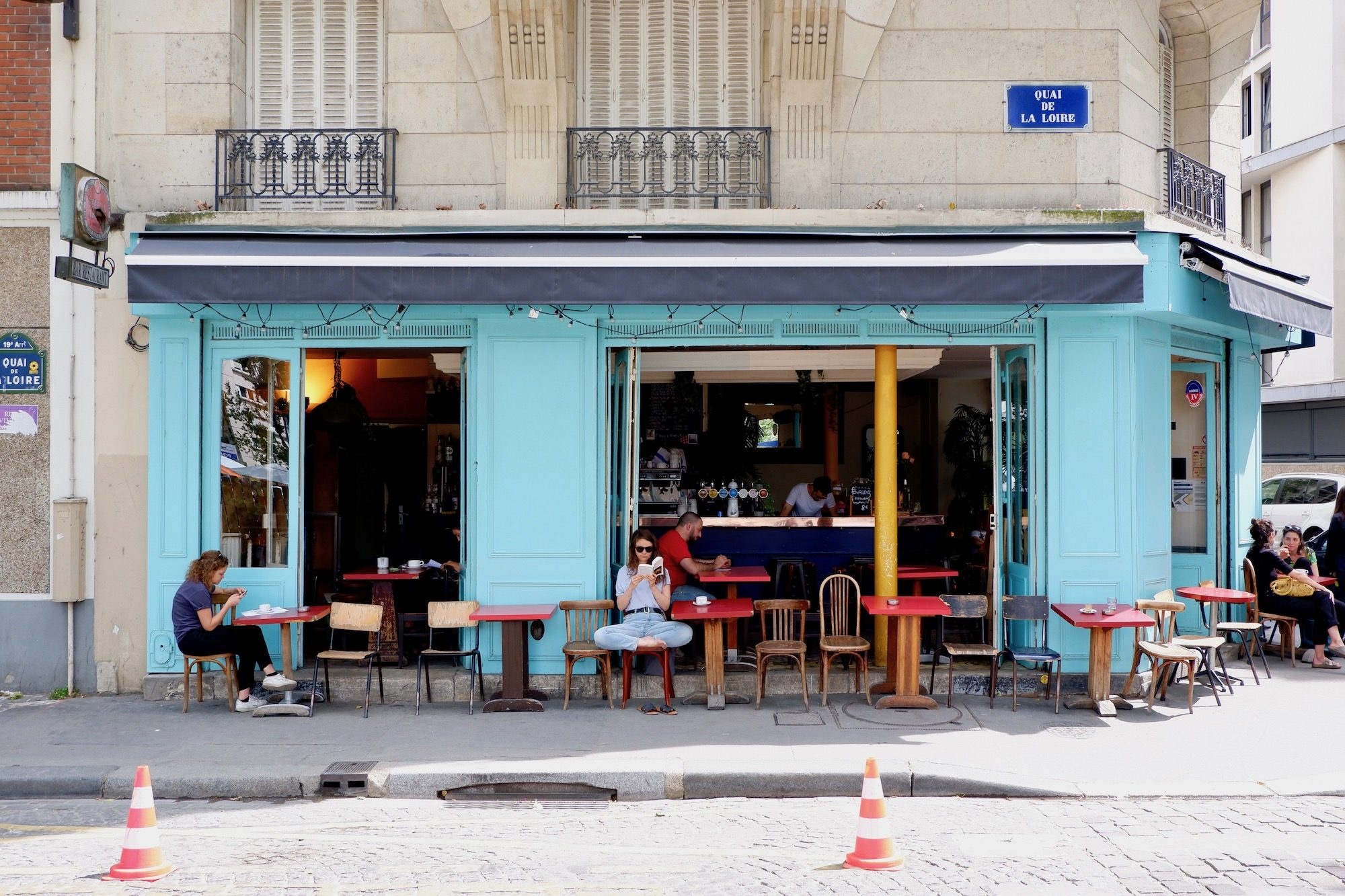 BarOurcq with its bright blue exteriors is one of the staple bars in the 19th arrondissement of Paris near the canal.
