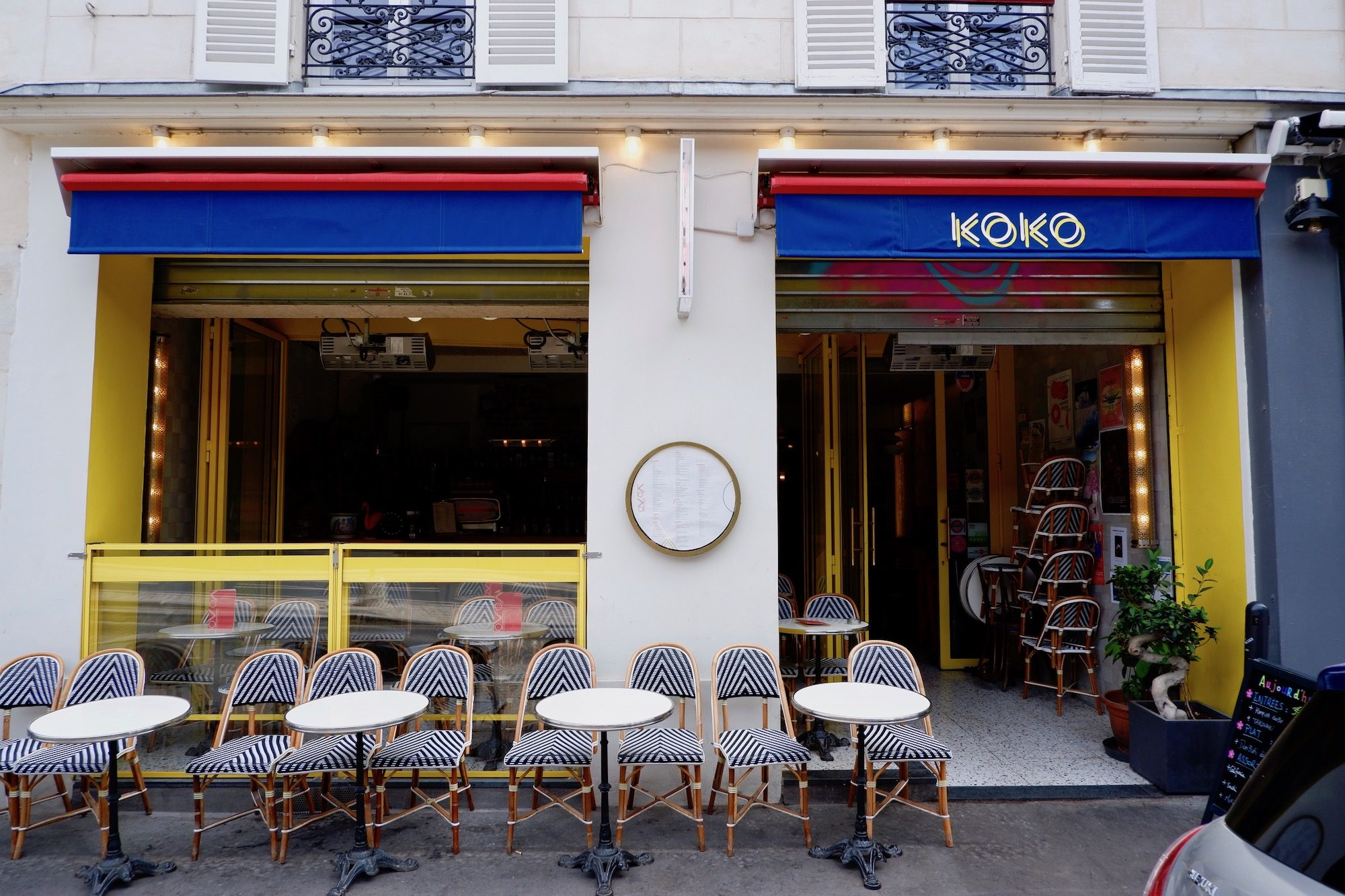 One of the quirky lively restaurants and bars on the canal de l'Ourcq, Koko Canal, with its bright yellow, red and blue exterior.