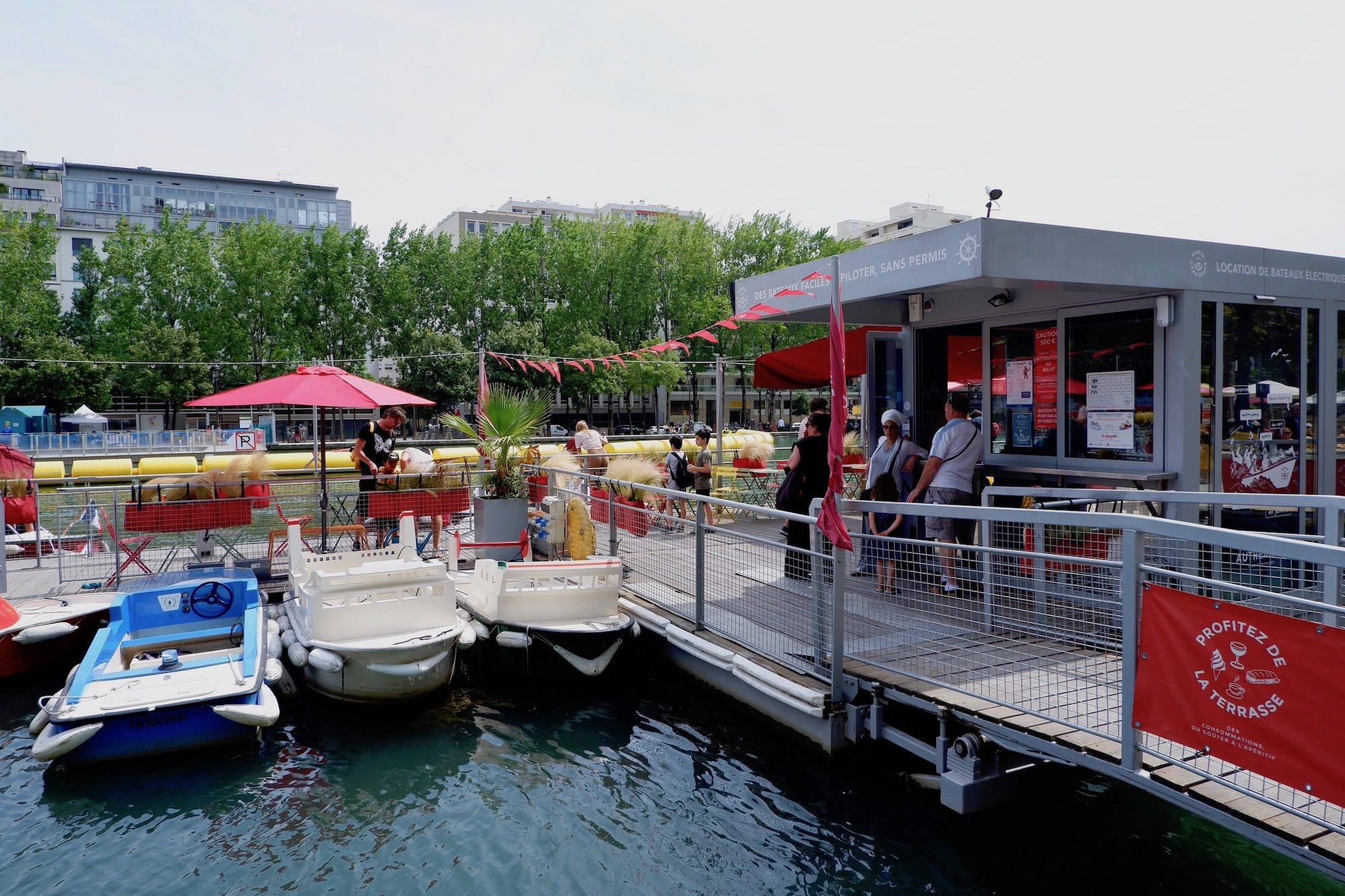 You can rent a small boat to sail along the canal in Paris from this floating pier.