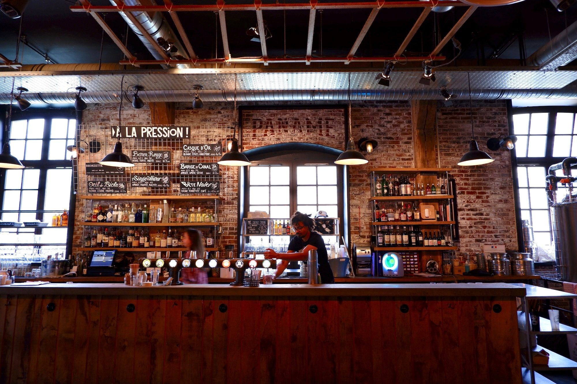 The counter of Paname Brewing Company, the popular craft beer bar on the canal in Paris.