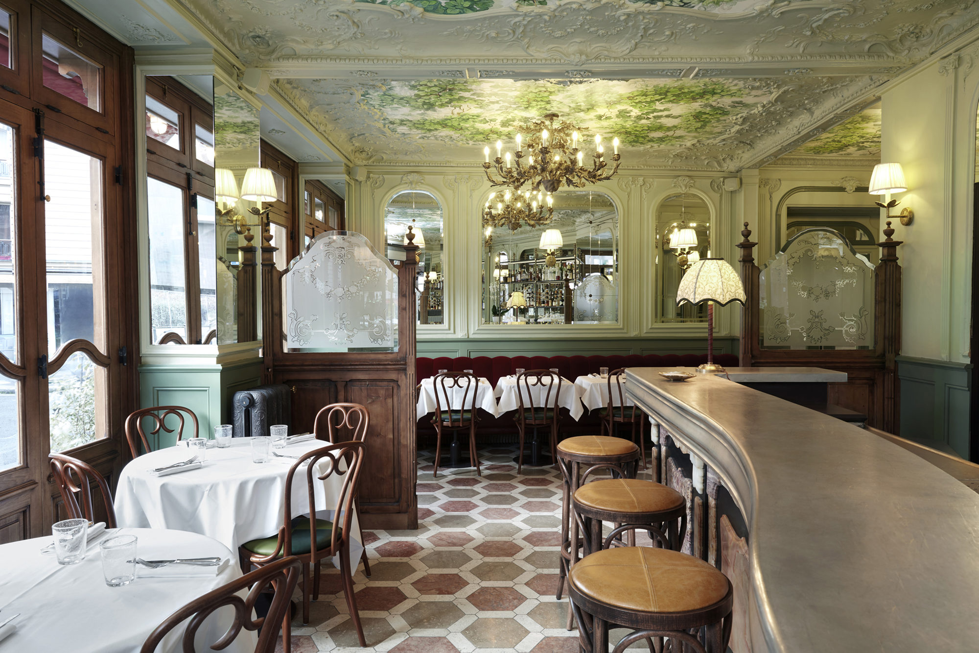 Le Chardenoux Paris bistrot Art Nouveau interiors with wooden tables, white table cloths and beautiful ceiling frescoes.