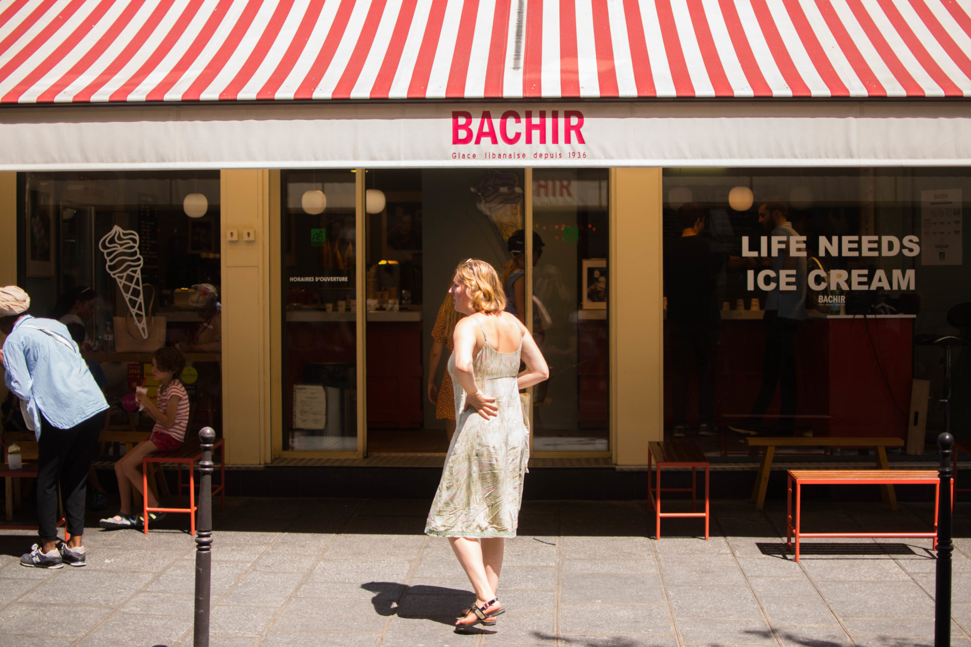 The exterior of Bachir ice cream shop in Paris with its stripy red and white awning.