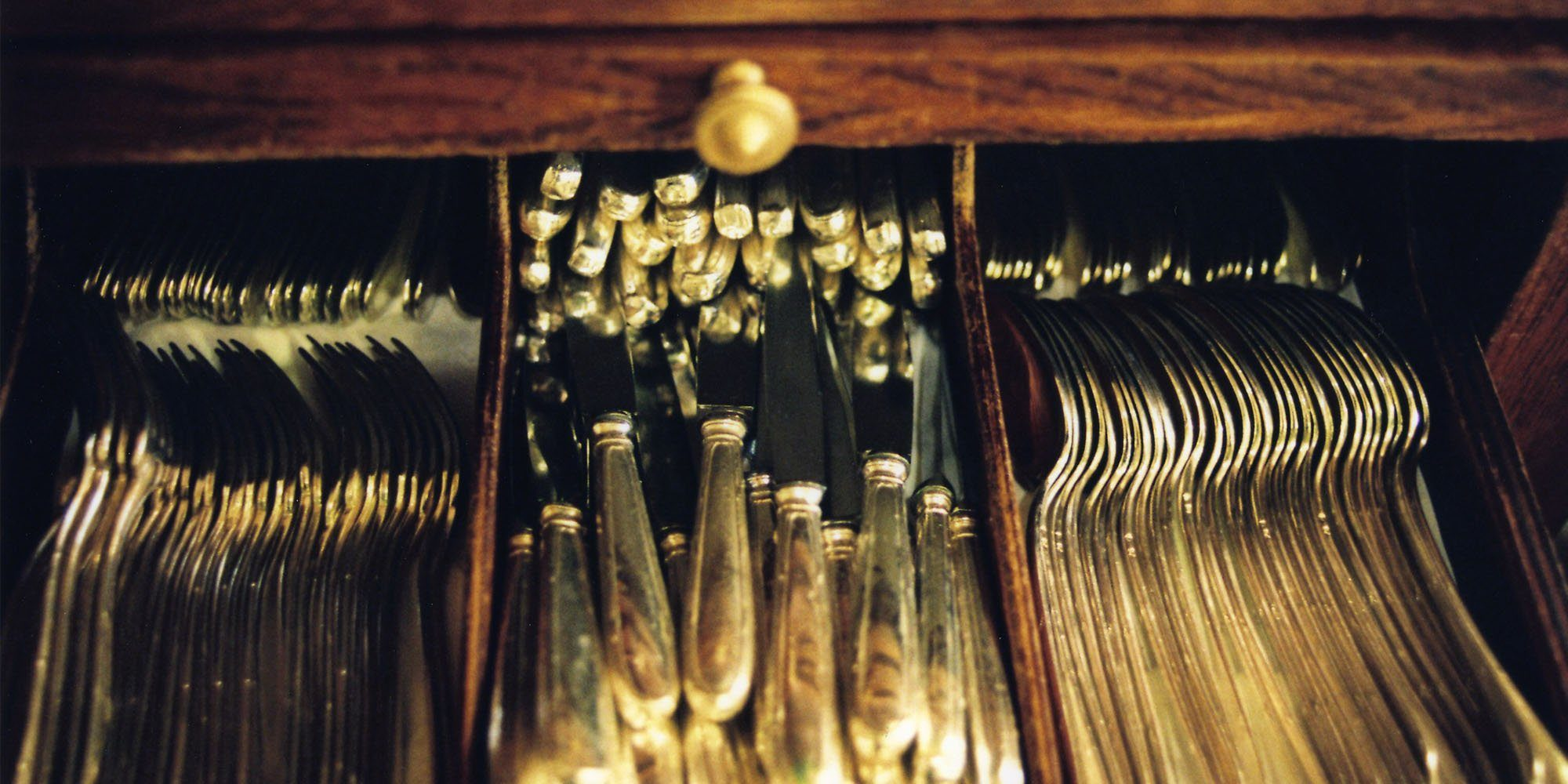 Culterly drawer filled with silverware at Benoit bistro in Paris.