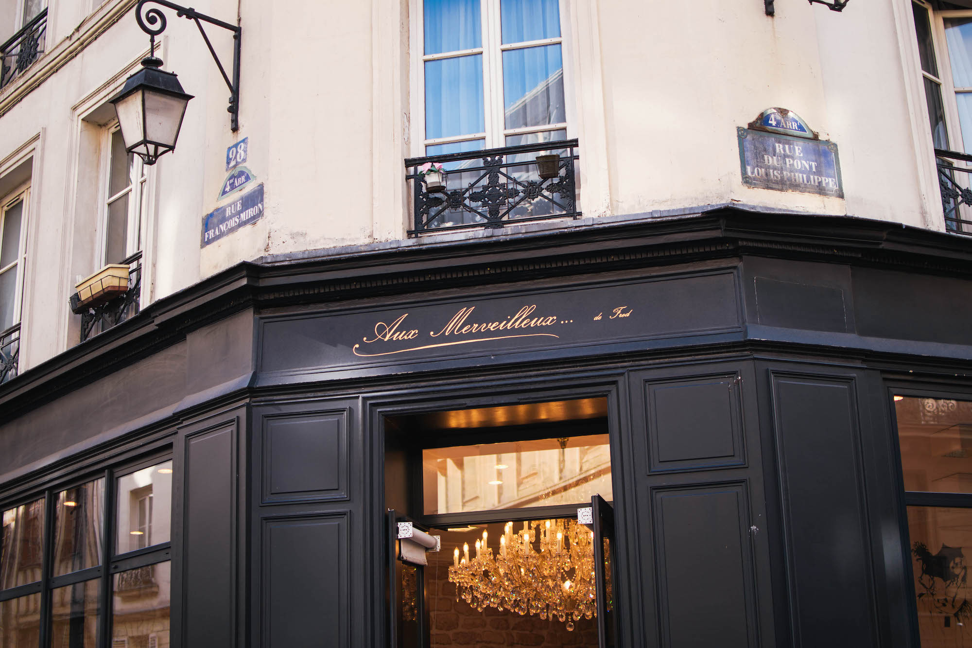 Aux Merveilleux de Fred, with a location in Paris' 4th arrondissement, is known for its delicate meringues. Step inside the shop to admire the pastries under the splendor of a crystal chandelier.