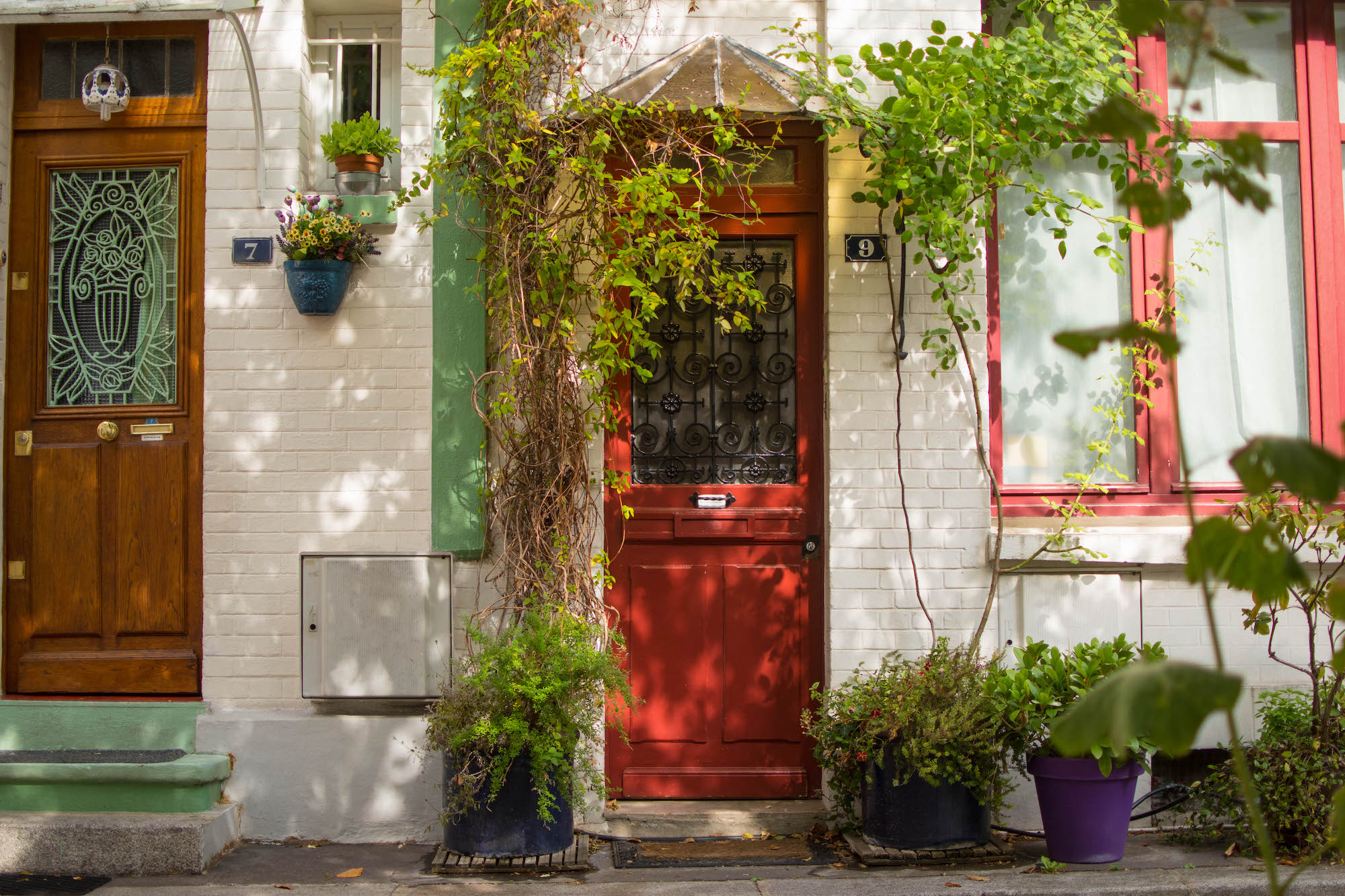 The Cité Florale, in the Butte-aux-Cailles neighborhood of Paris' 13th arrondissement, is filled with homes and potted plants spilling onto the tiny streets.