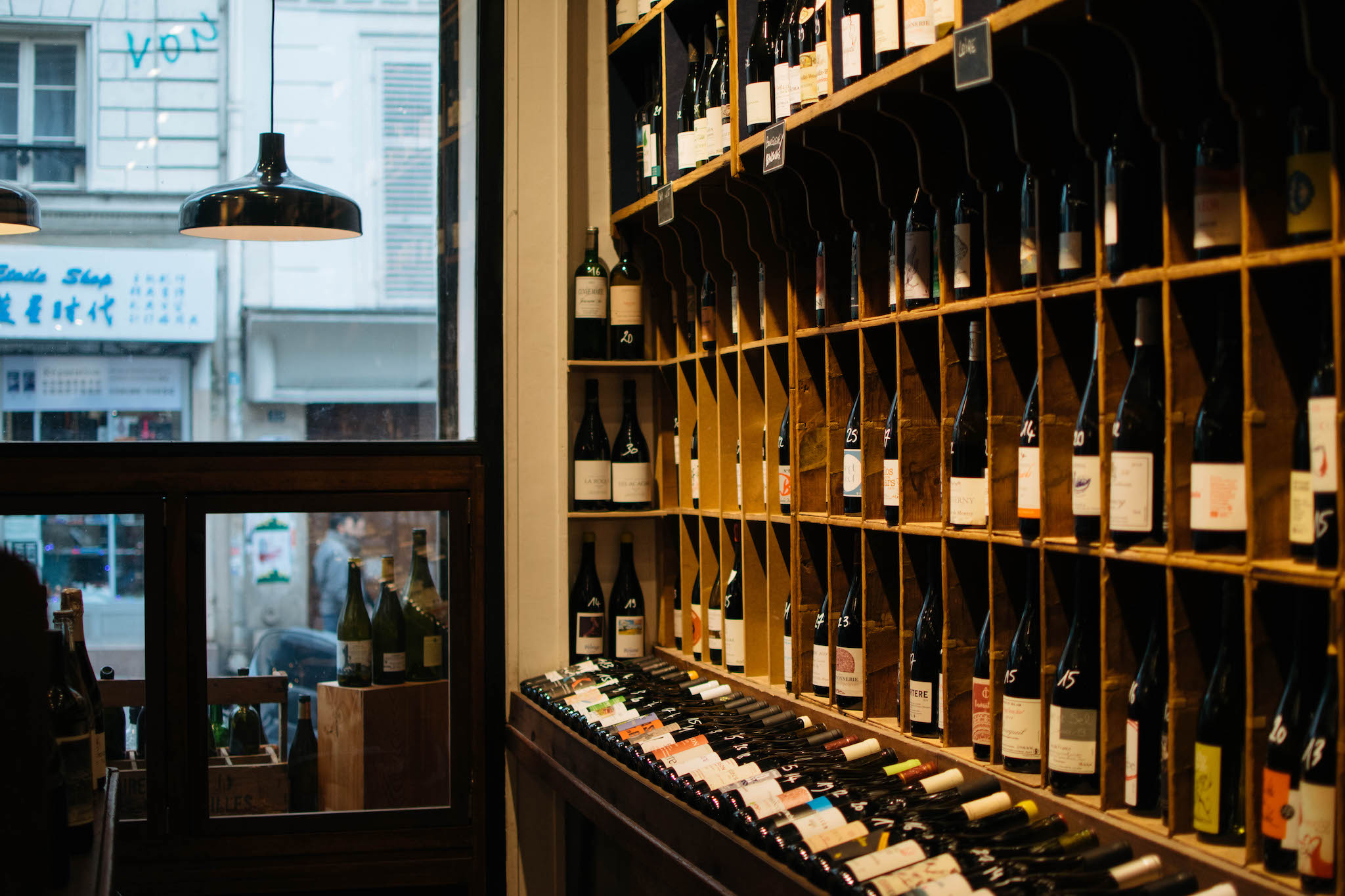 A wide selection of natural wines is shelved at La Cave de Bellville, a natural wine bar in Paris.
