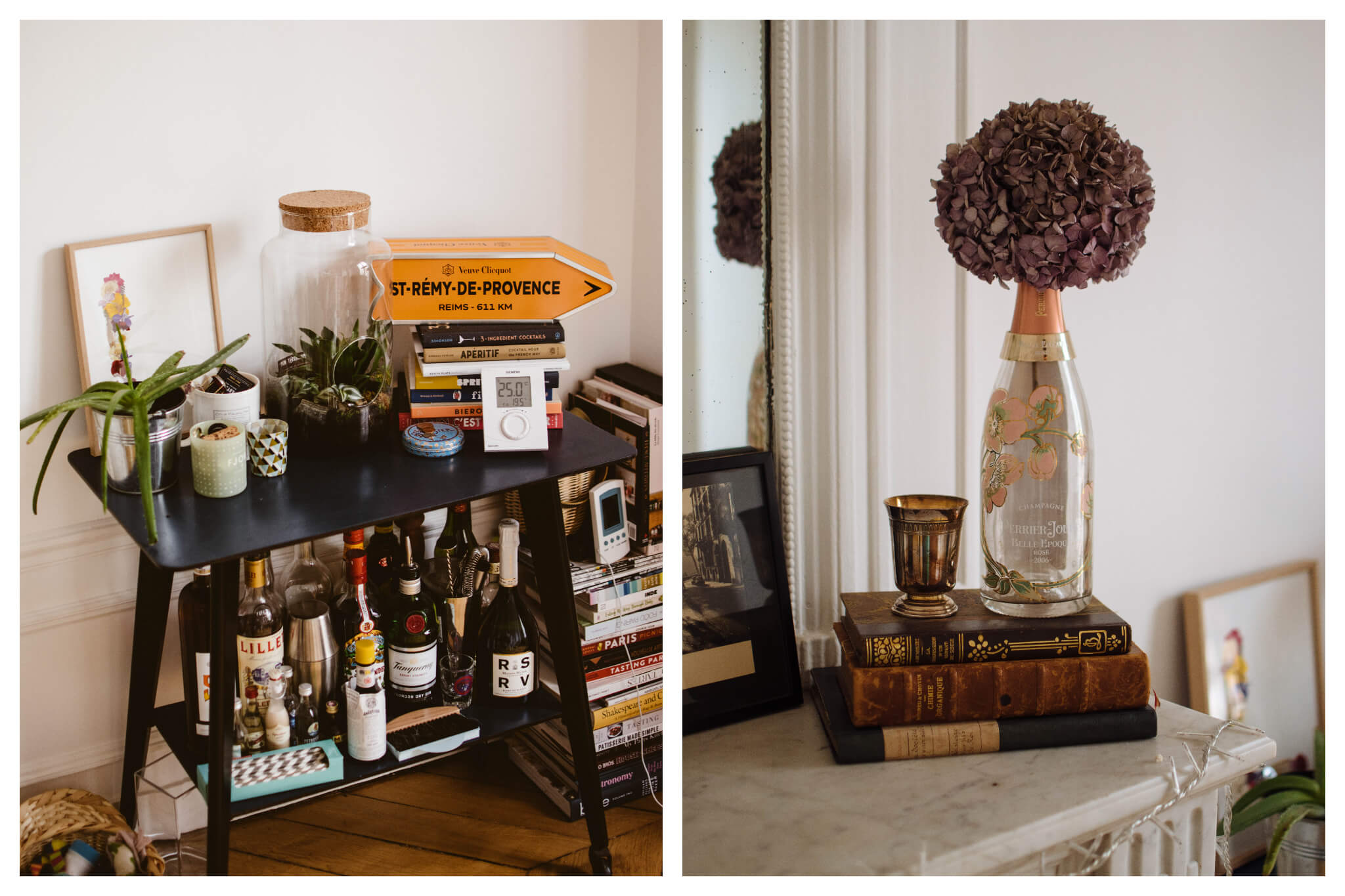 Left: Assorted items are seen on, under and next to a black shelf in an apartment, including a stack of books and bottles of alcohol, Right: Assorted items sit next to a mirror atop a fireplace in an apartment, including a stack of books and a vase of flowers made from an old champagne bottle.