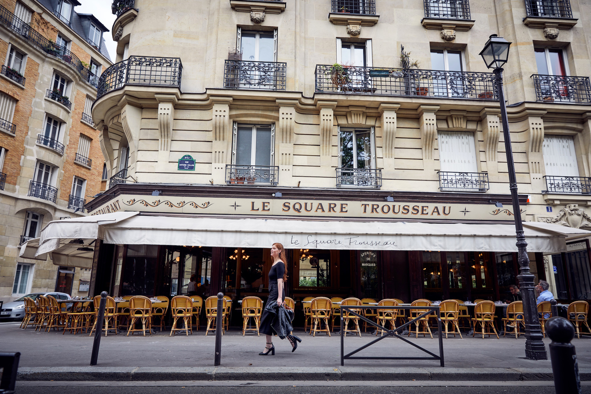 A café and its terrace laid out under its awning in Paris.