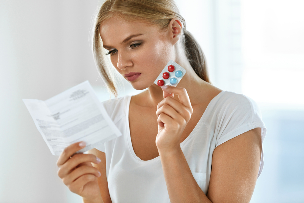 Image of a woman taking prescription medication.