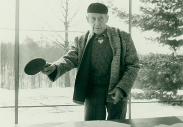 Walter Gropius playing ping pong, Gropius House, Lincoln, Mass.