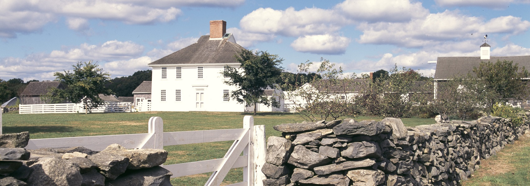 Farmhouse, barn, and stone wall at Casey Farm