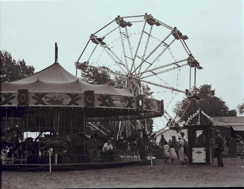 View of the Ferris wheel and merry go round, Topsfield Fair, 1933.