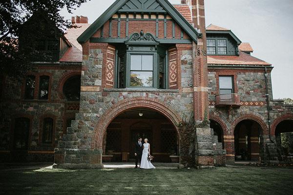 A bride and groom outside the Eustis Estate mansion