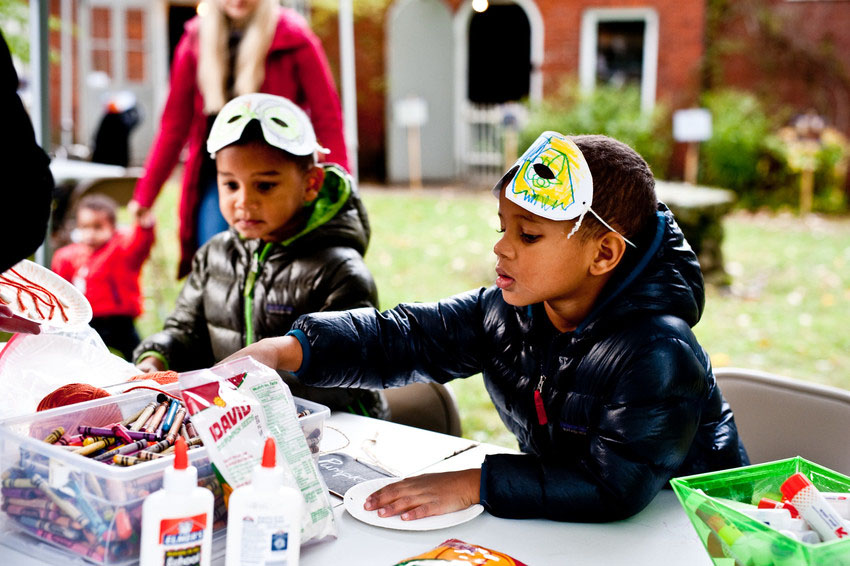 Children wear masks and make Halloween crafts at Wicked Wednesdays at Phillips House