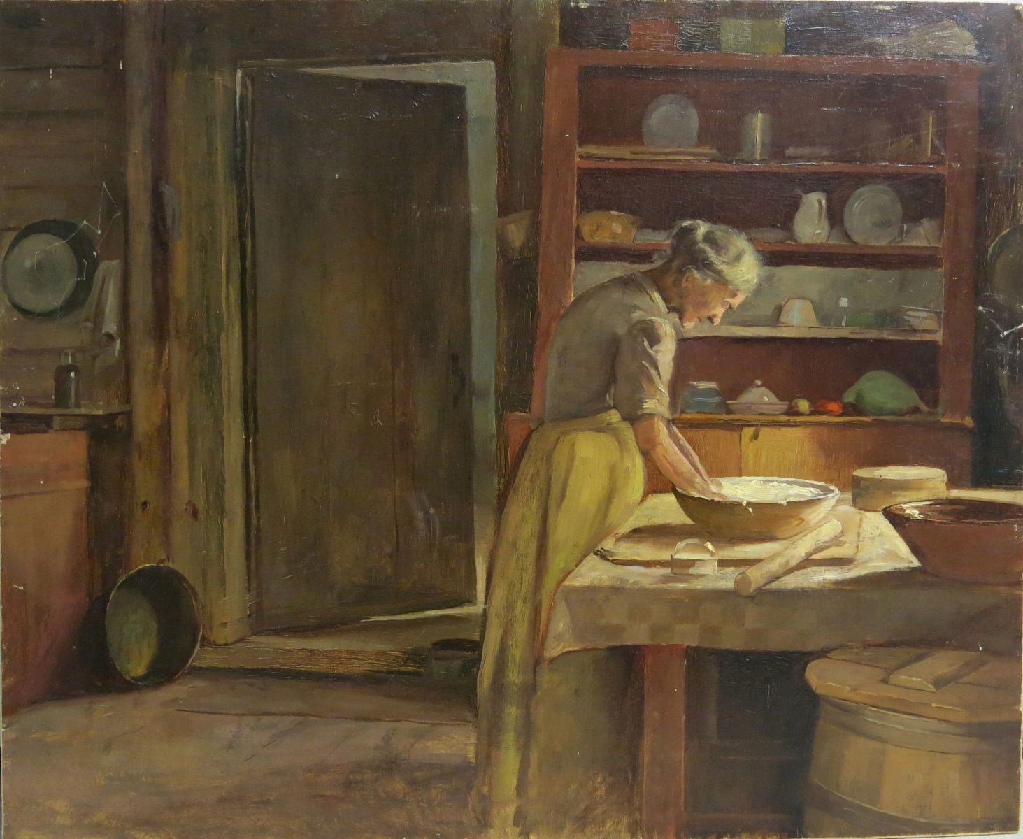 Painting of woman baking bread in the kitchen