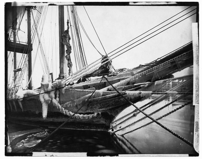 Docked schooner covered in ice
