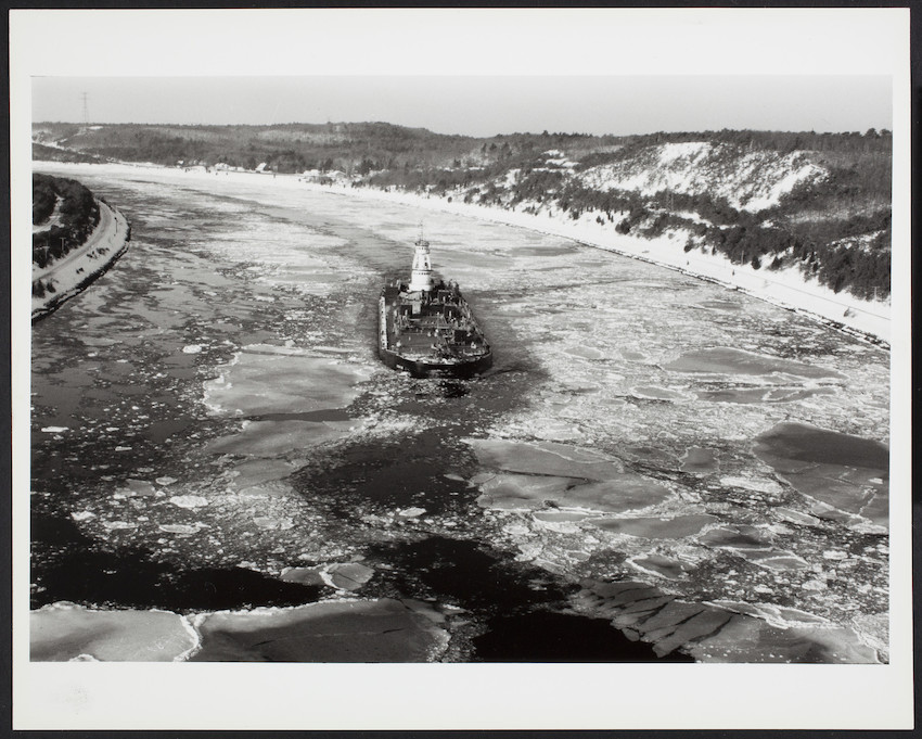 A ship traverses an icy Cape Cod canal