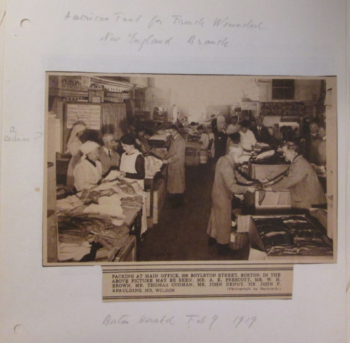 A page from Dorothy Codman's American Fund for French Wounded scrapbook. Dorothy is identified in the background of a photo which ran in the Boston Herald.