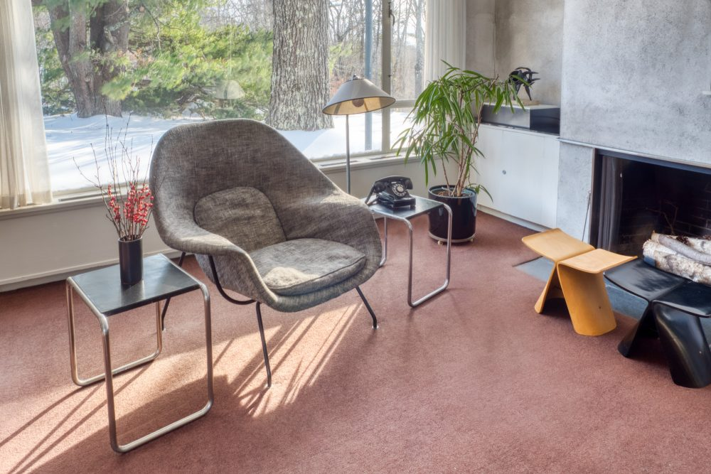 Interior of Gropius House living room with chair and fireplace