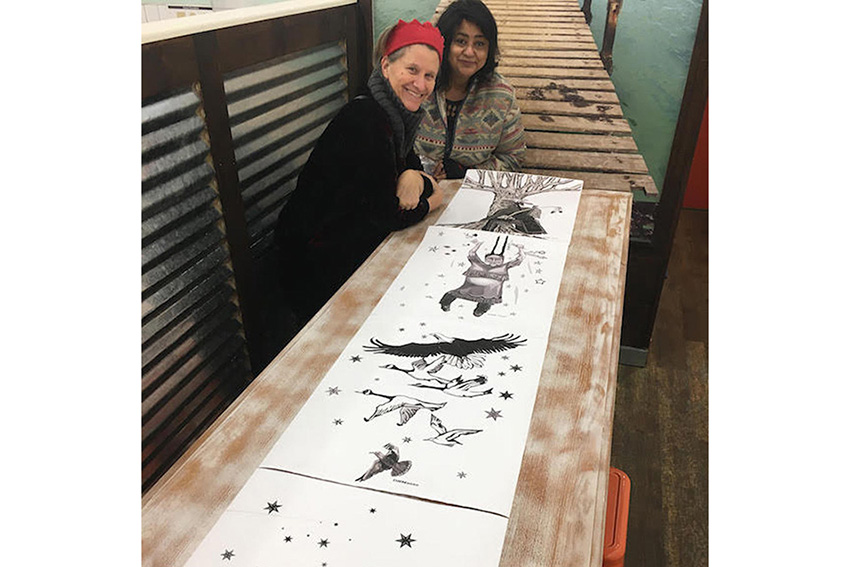 Artists looking at drawings for RainKeep