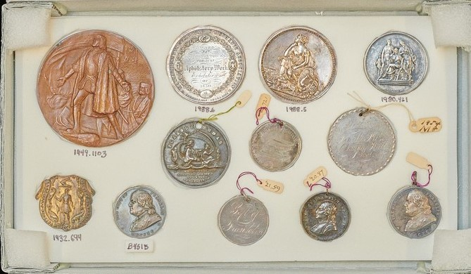 Photograph of various medals from the Historic New England collection