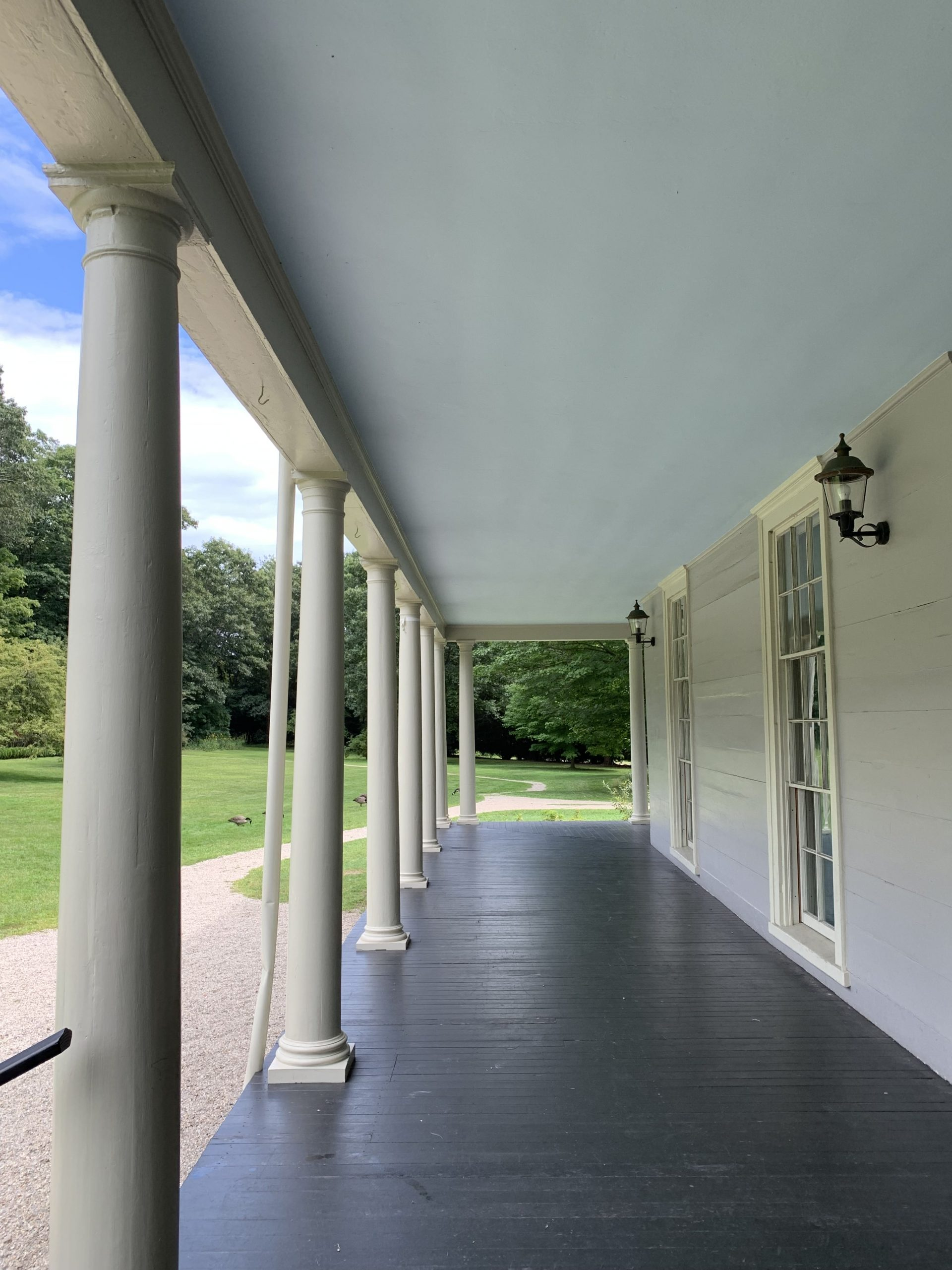 A photo of the underside of the roof of the Lyman Estate's veranda. It is a light blue color.