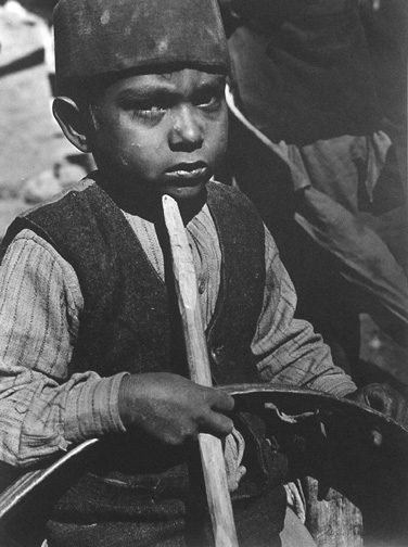 Muslum Boy With Hoop and Stick Game