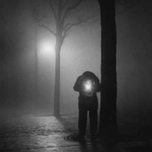 Homme de Nuit Illumant sa Cigarette, Paris