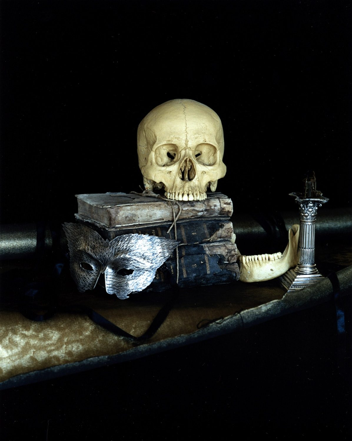 Still life with a silver mask