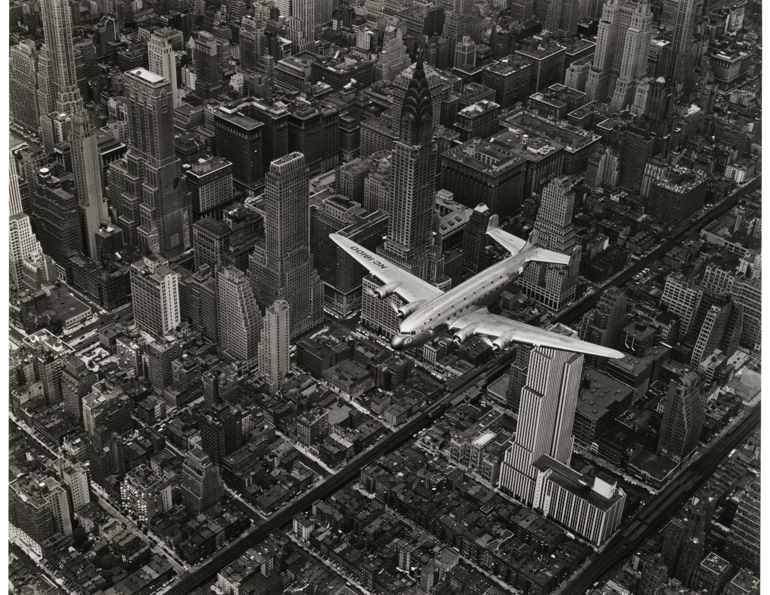 DC-4 Flying Over New York City