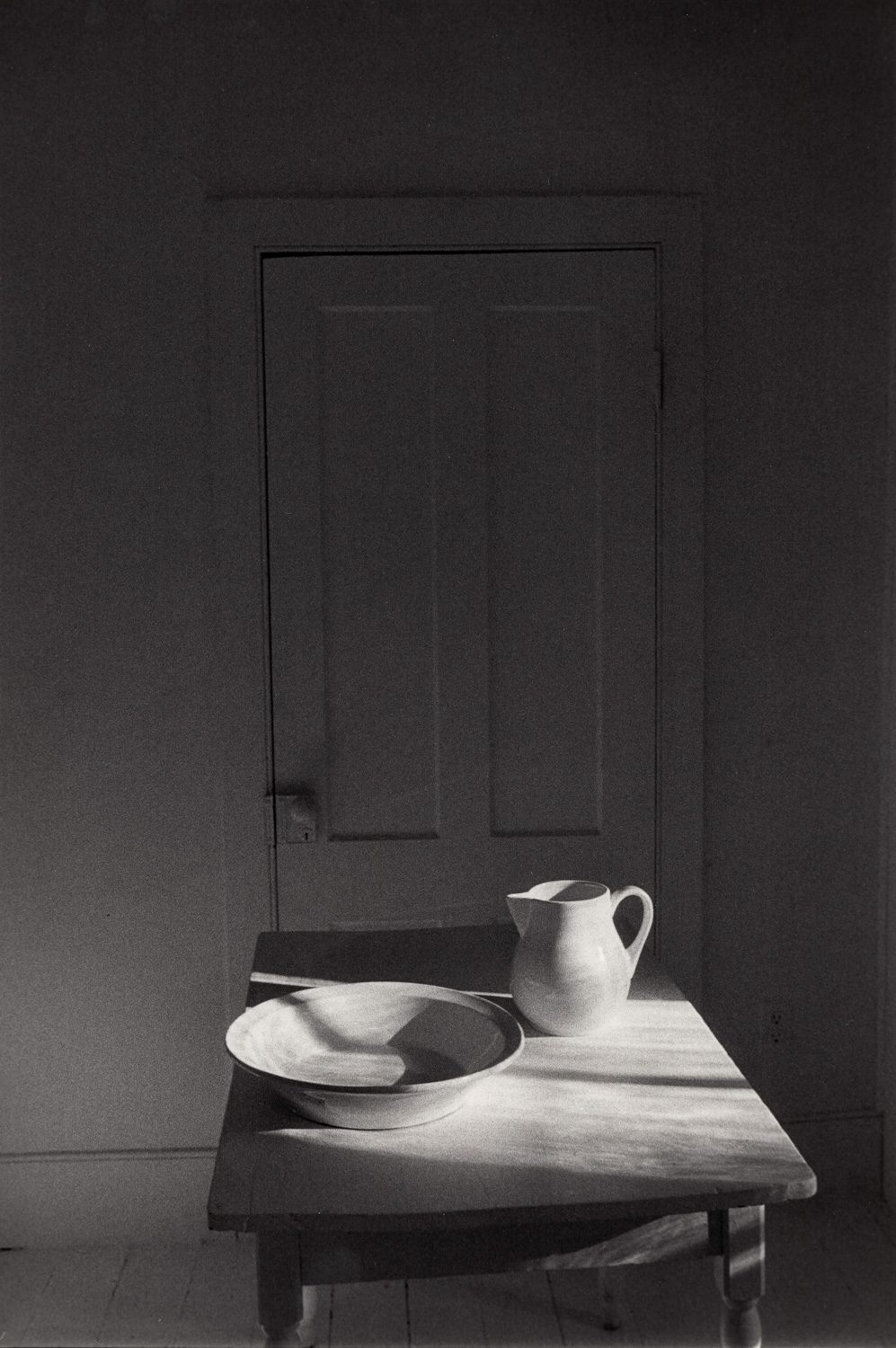 Pitcher and Bowl on Table in front of Door